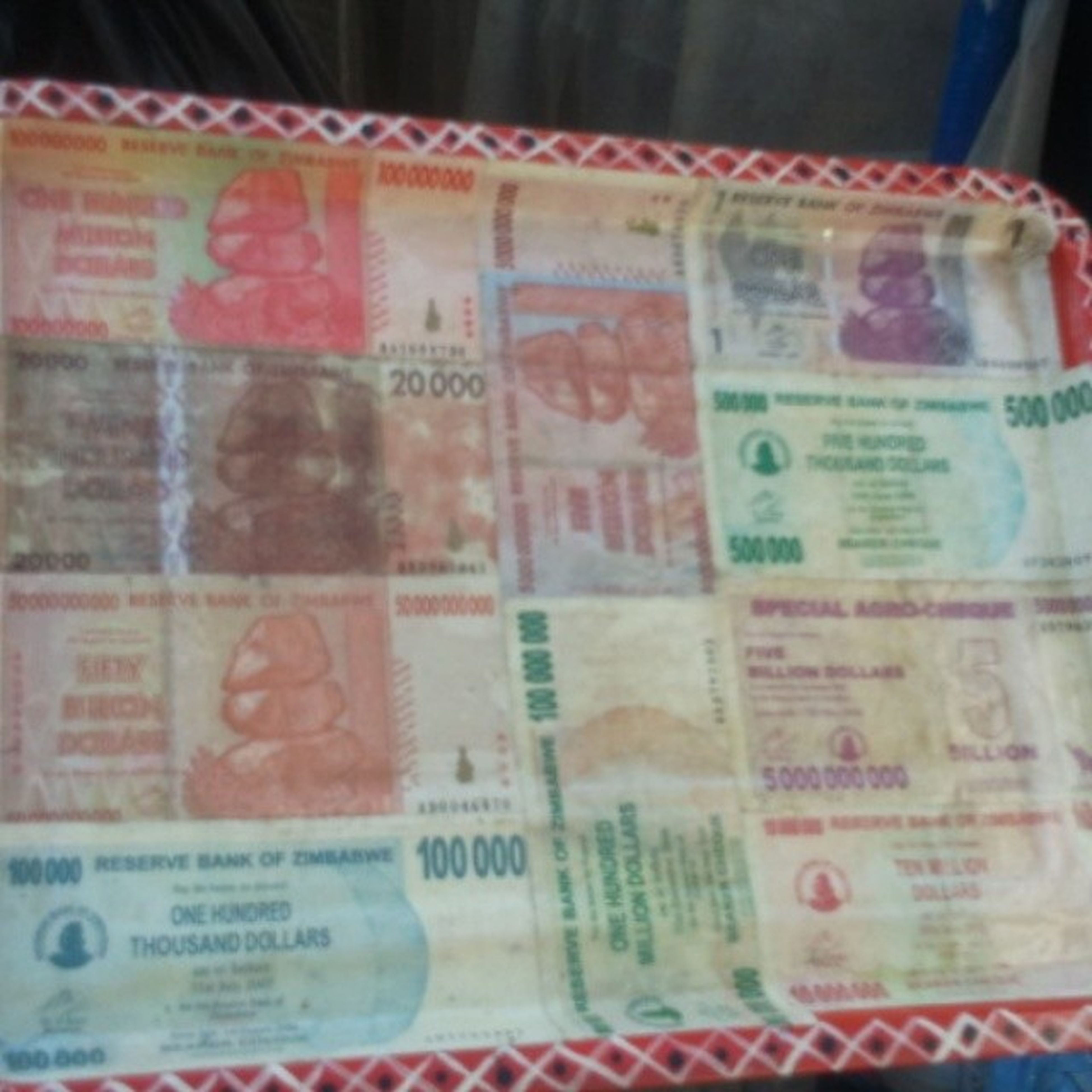 So we're walking around looking for some arts and crafts ish and we run across this...a tray made of SOME of the notes that were used in Zimbabwe back in the day! No doubt my holiday has been made. Yes people there was a 10 million dollar note...but that was the least of em! TheHomecoming MyZimbabwe MoneySpenders We Balling Like That 10YearOldBillionaires This Some Bill Gates Money Carlos Slim Got Nothing On Us