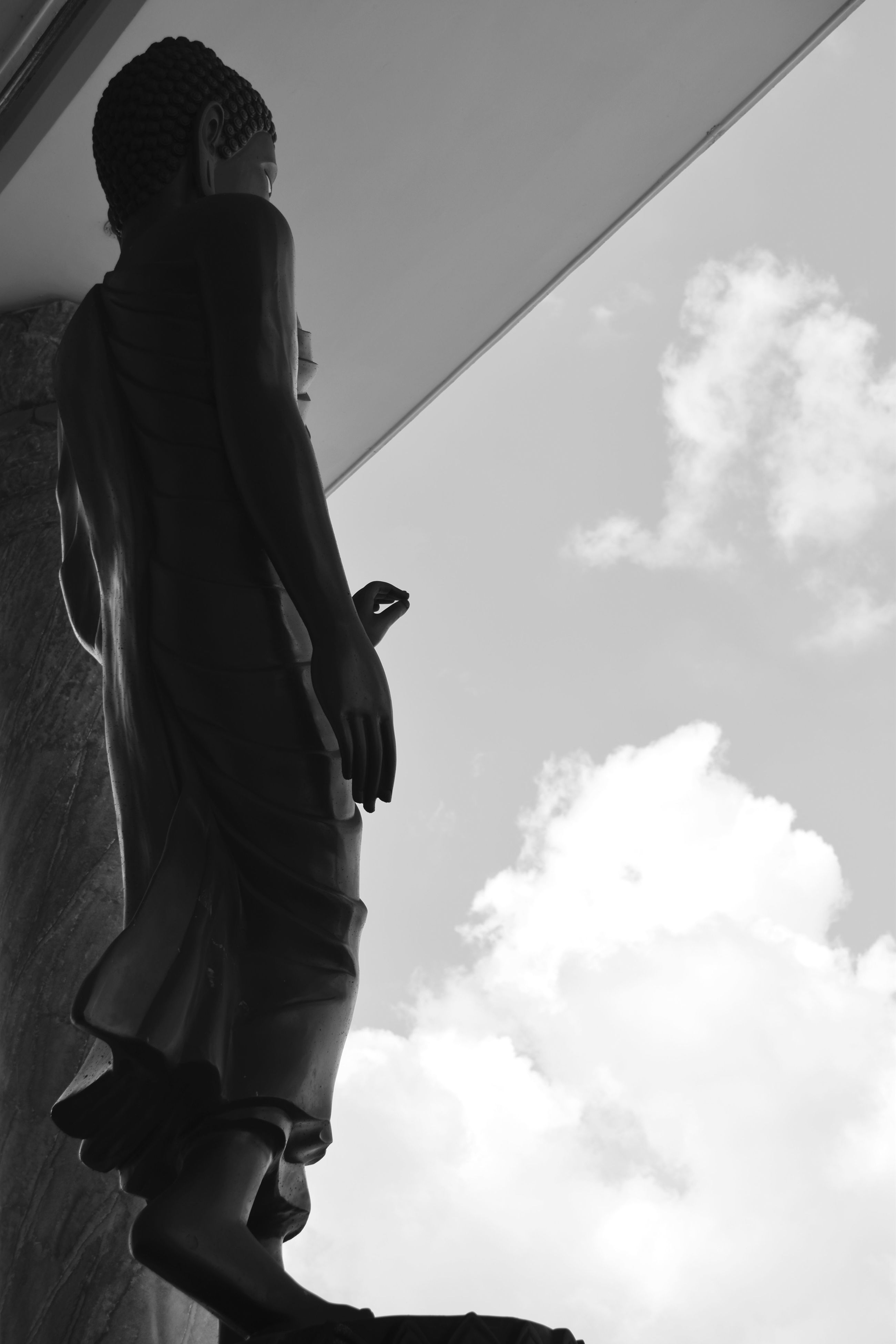 statue, low angle view, sky, human representation, cloud - sky, sculpture, male likeness, outdoors, day, architecture, building exterior, real people, one person, people