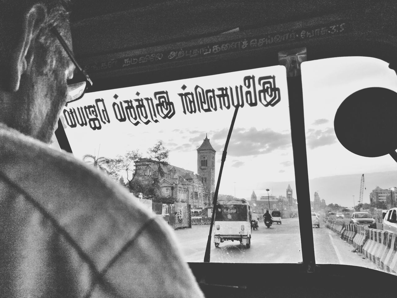 Text Communication Day Outdoors Adult City People One Person One Man Only Adults Only Sky Only Men TheWeek On EyEem Monochrome Blackandwhite Bnw Rickshaw Auto Madras Chennai India Ride The Week On EyeEm Architecture