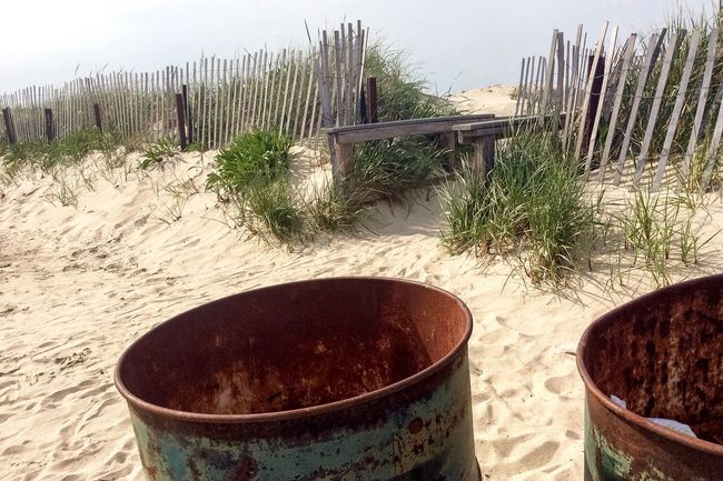 Beauty In Nature Beauty Of Decay Beauty In Ordinary Things Sandy Sand Dune Sandy Beach Fence Rust Rusty Barrel Decay No People From My Point Of View