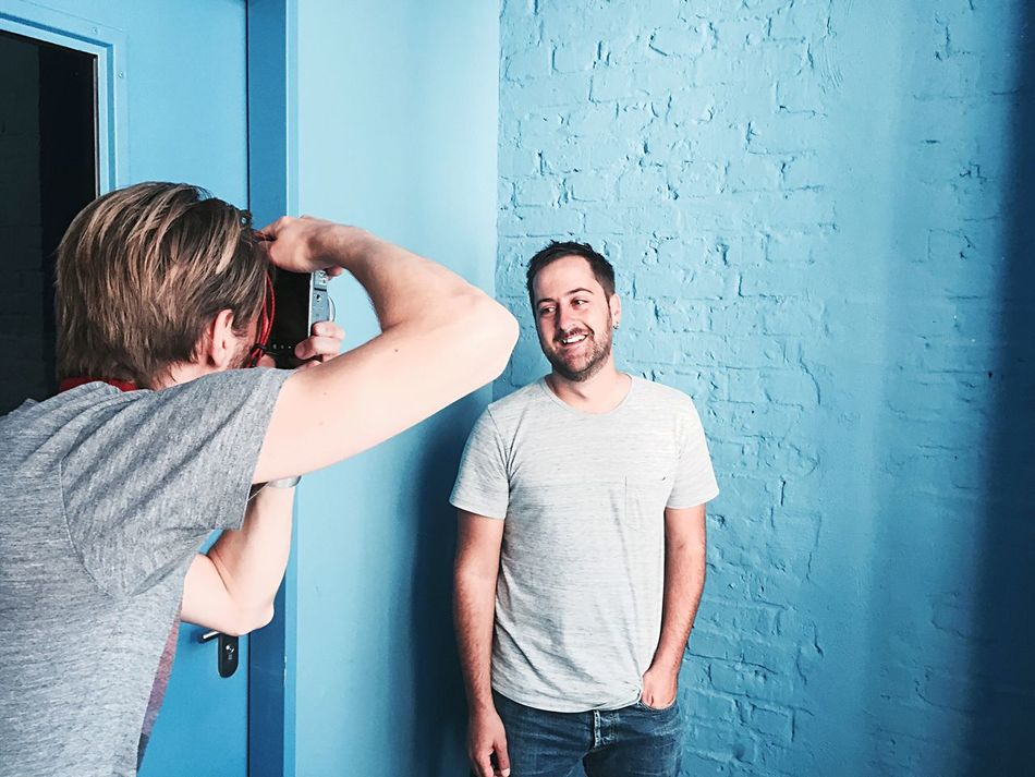 Person Waist Up Wall - Building Feature Casual Clothing Standing Leisure Activity Young Adult Young Men Looking At Camera People Taking Photos Smiling Eyeem Studio Kreuzberg