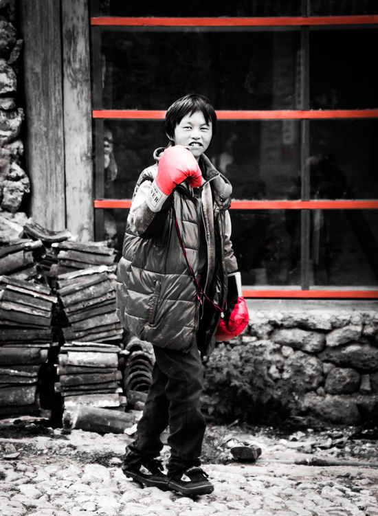 Shot taken in a remote village, where Dr Rock thrive in early 1900. Boxing Casual Clothing Childhood EyeEm Best Shots Gang Gangsters Paradise Lifestyles Real People Red Gloves Standing Young Adult