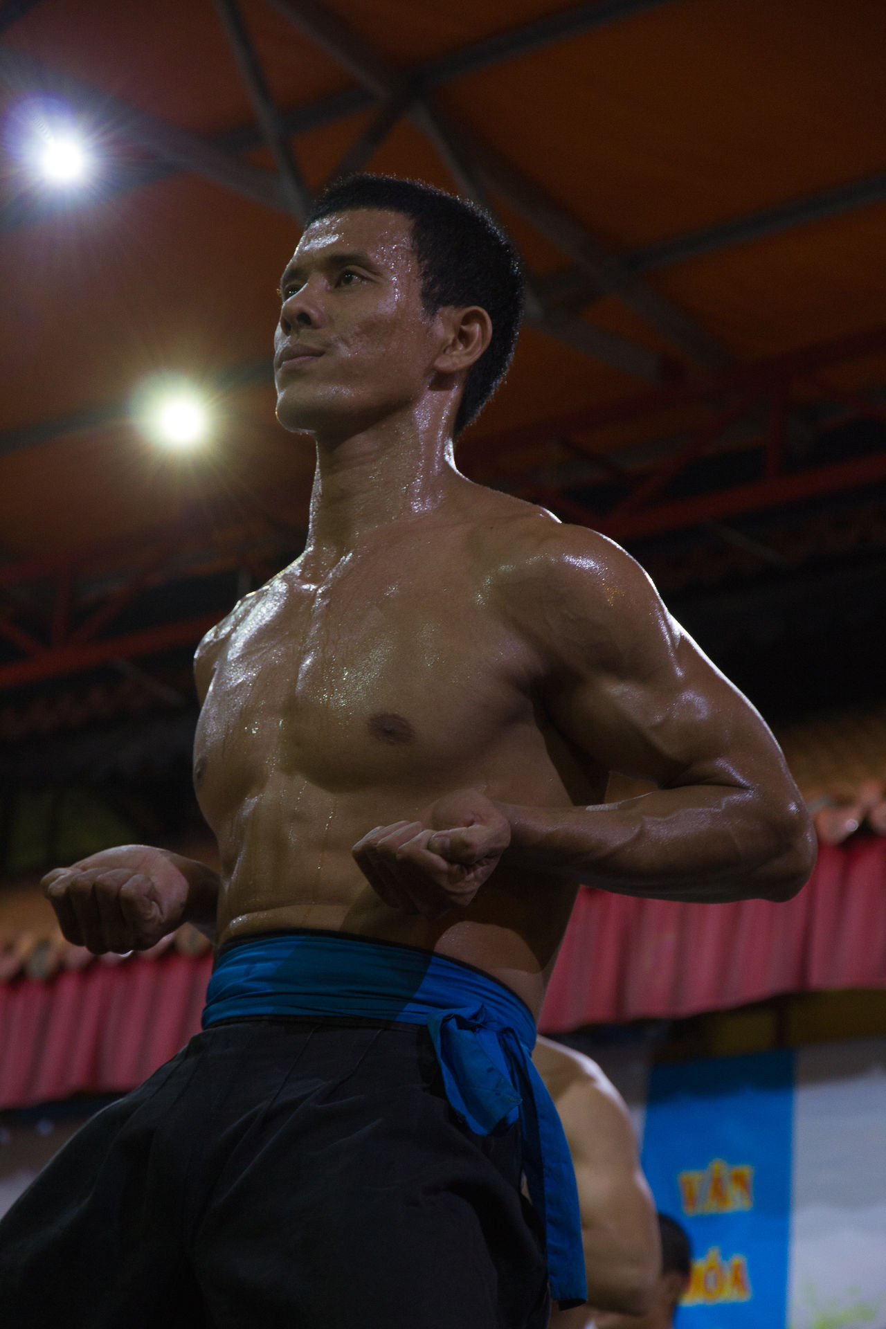A level-up contestant of traditional Vietnam kungfu Adult Athlete Determination Exercising Healthy Lifestyle Indoors  Kungfu  Muscular Build Night Nightphotography One Person Practise Self Improvement Sport Sportsman Vietnam Vietnamese Young Adult
