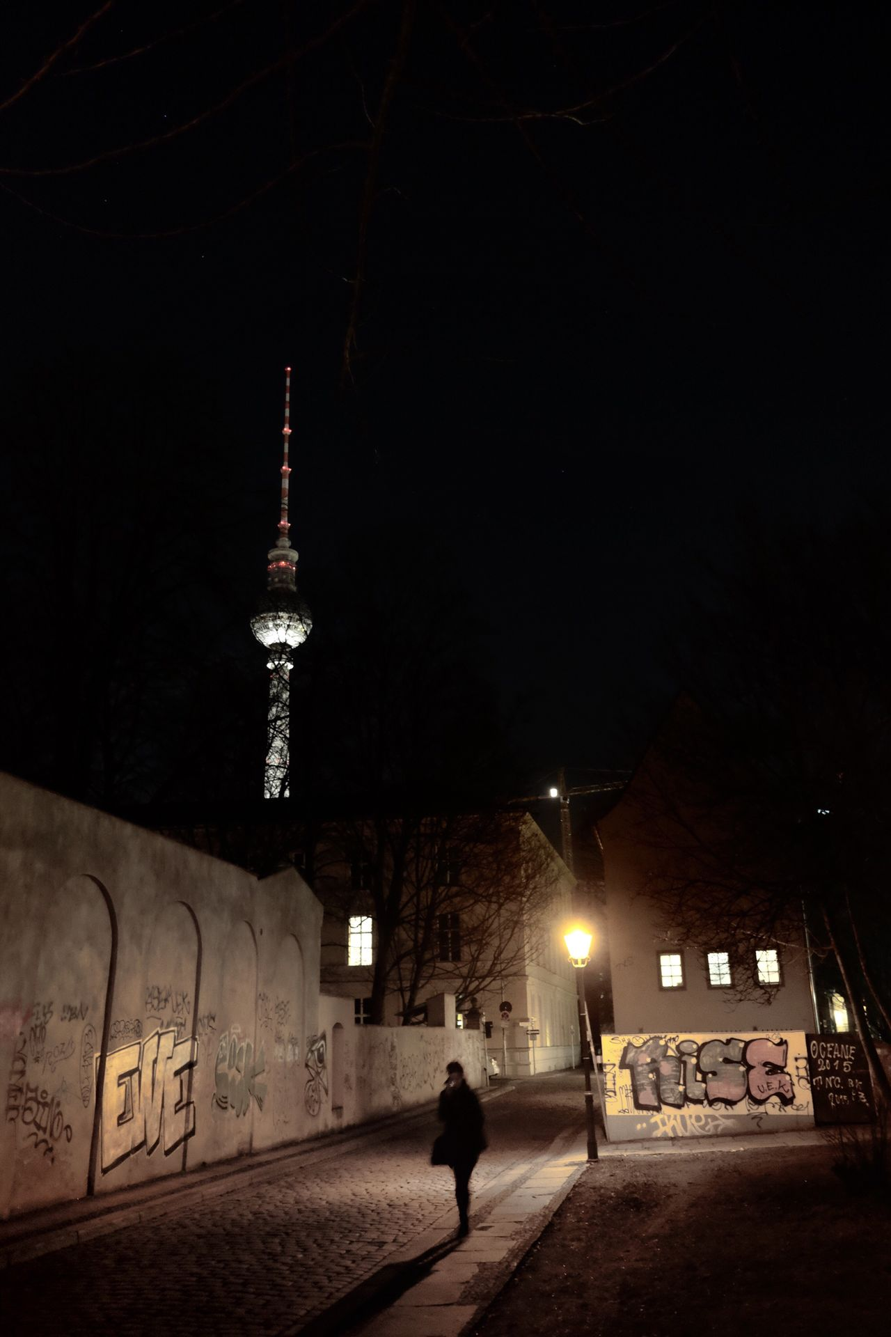 Night Illuminated Built Structure Architecture Walking Building Exterior Travel Destinations Outdoors City Real People One Person Tower Place Of Worship People Berlin That Tower Again