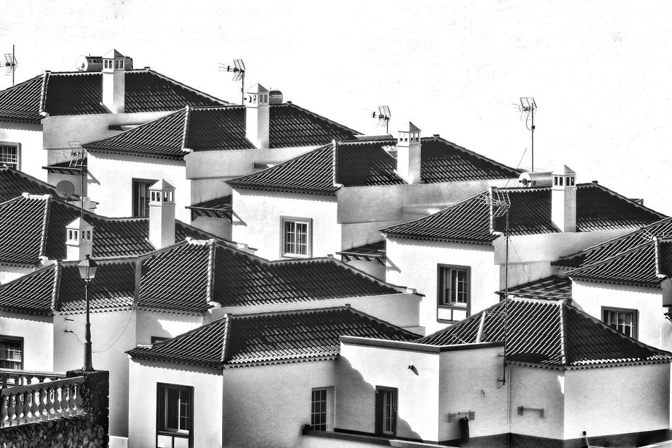 Building Exterior Architecture Built Structure Window Day Outdoors No People Tiled Roof  House Sky Residential Building Town Clear Sky City Black And White