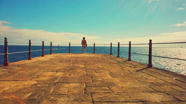 Beach Cobblestone Connection Distant Full Length Horizon Over Water Incidental People Jetty Leading Lifestyles Men Outdoors Pier Railing Sea Sidewalk The Way Forward Vacations Walking Water