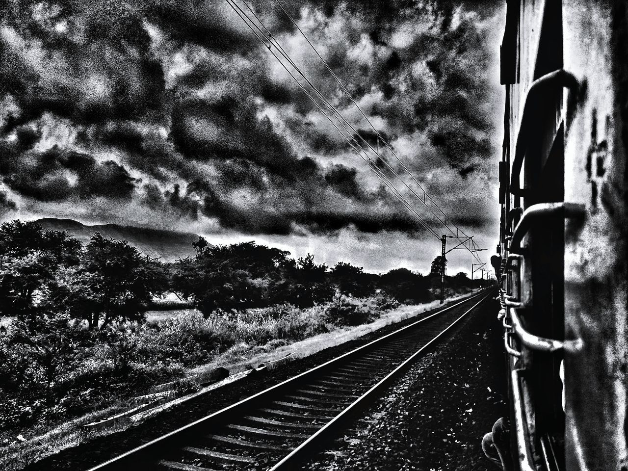 Railroad Track Transportation Rail Transportation Sky The Way Forward No People Mode Of Transport Public Transportation Outdoors Day Nature Tree EyeEm Black&white! Travel Destinations Edit India Oneplus2 EyeEm Gallery Mobilephotography Windows Train Journey Window View Abstract Photography Abstract Surreal