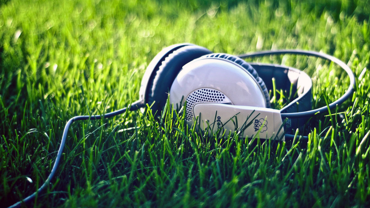 Music in Summer. Communication Day Field Grass Green Color Growth Headphone Music Nature No People Outdoors Playing Field Sommergefühle Sport Summer Summertime