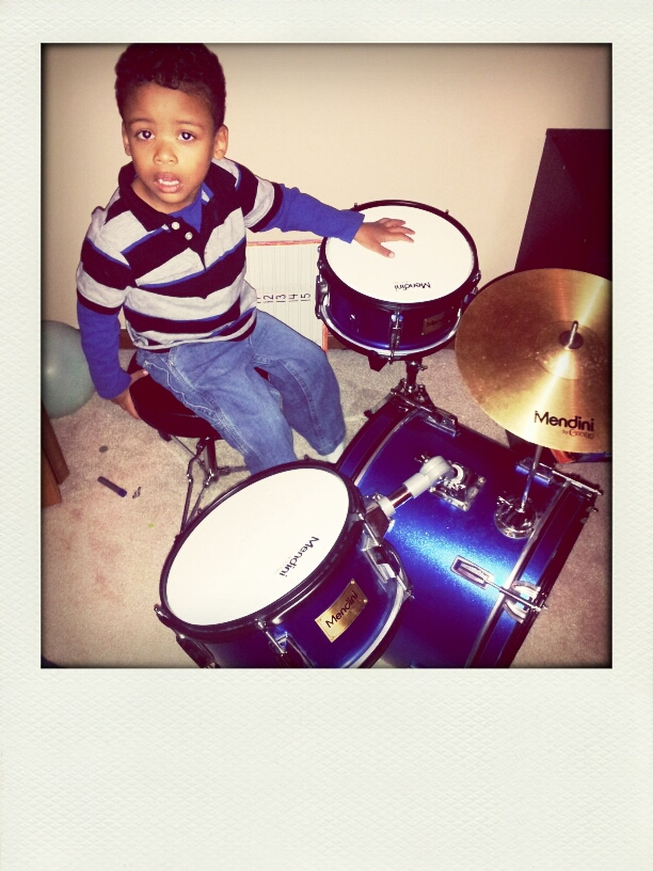 Practicing to become a future drummer
