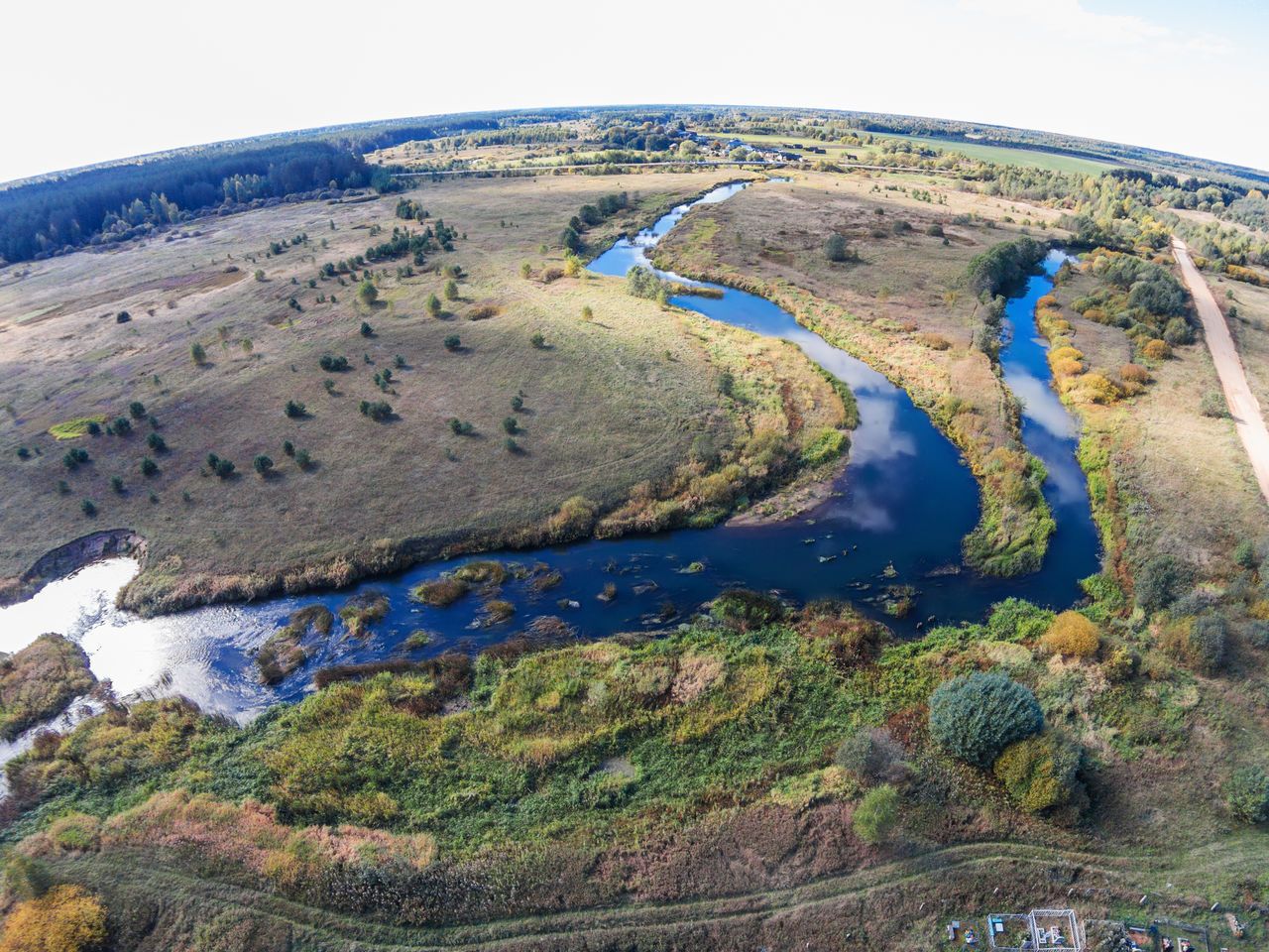 """Vorozhba River flows into the river Volchina. From the series """"Flying in the hamlet Lunacharsky."""" A Bird's Eye View Aerial View Beauty In Nature Blue Day Drone  Dronephotography Grass Landscape Nature No People Outdoors River Scenics Top Perspective Tranquil Scene Tranquility Water"""