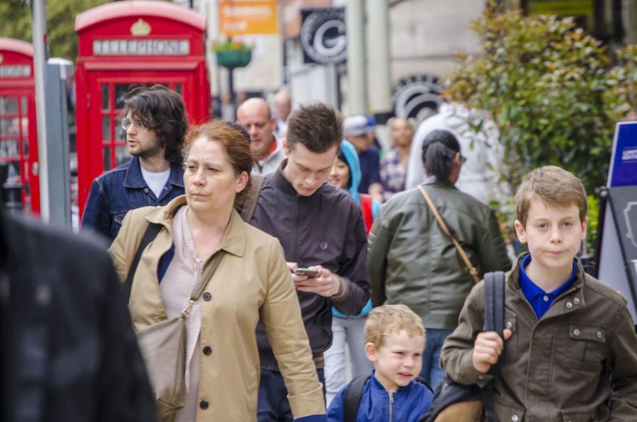 People hurry down a busy street in Bayswater, London. Busy City Living Hurrying Lifestyles Pedestrians People Street Telephone Box Telephone Boxes Walking