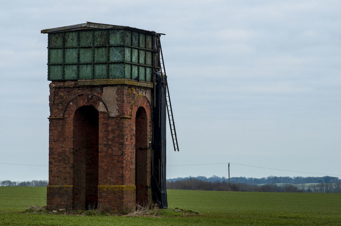 Arch Built Structure Connection Exterior Historic History Ladder To Nowhere No People Outdoors The Way Forward Tree Trunk Unusual Building Unusual Structure Water_collection Water Tower Water Tower? Water Towers
