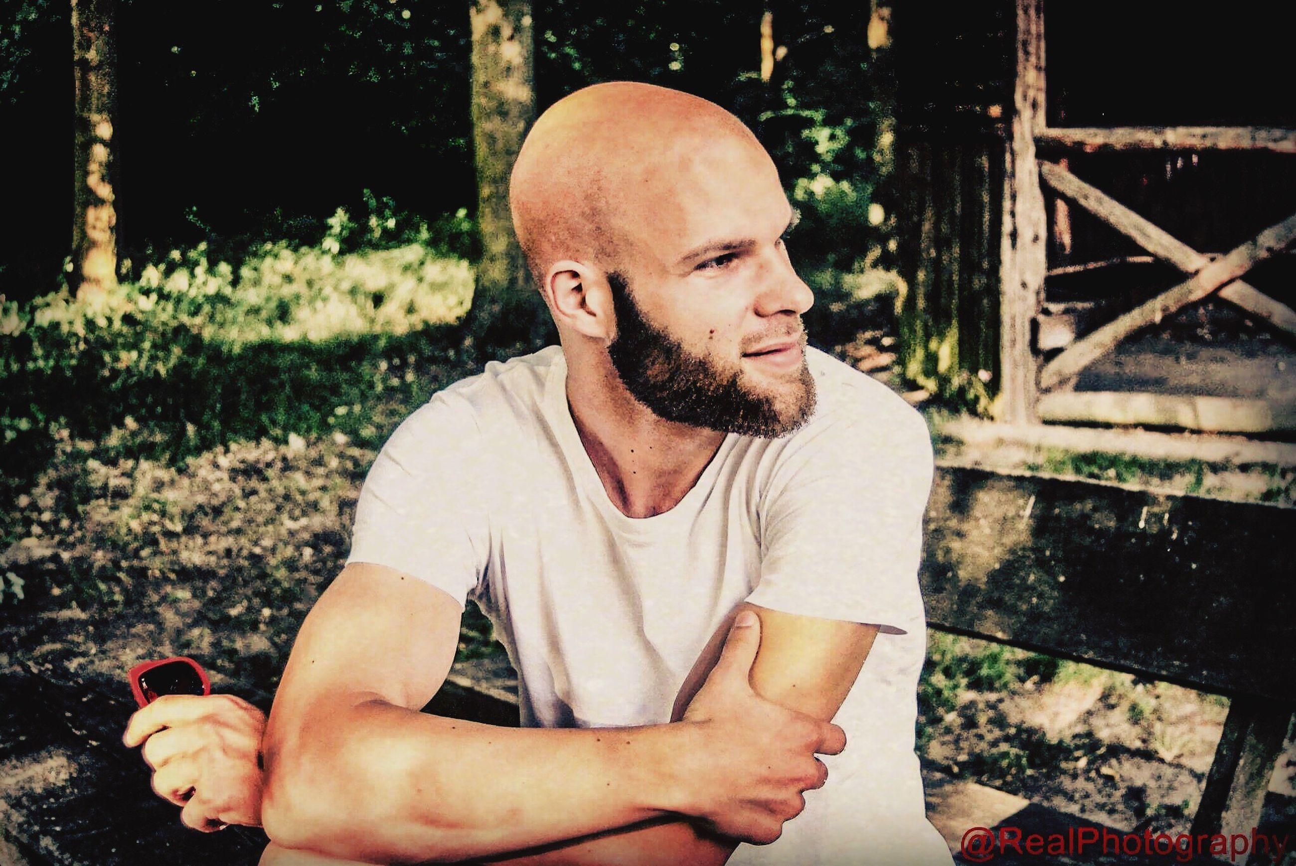 one person, mature men, real people, mature adult, casual clothing, outdoors, mid adult men, lifestyles, leisure activity, sitting, beard, nature, day, young adult, adult, people
