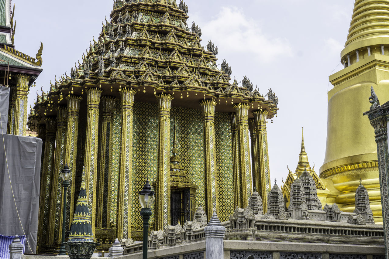 religion, architecture, spirituality, place of worship, built structure, building exterior, travel destinations, history, low angle view, gold colored, sky, day, outdoors, no people