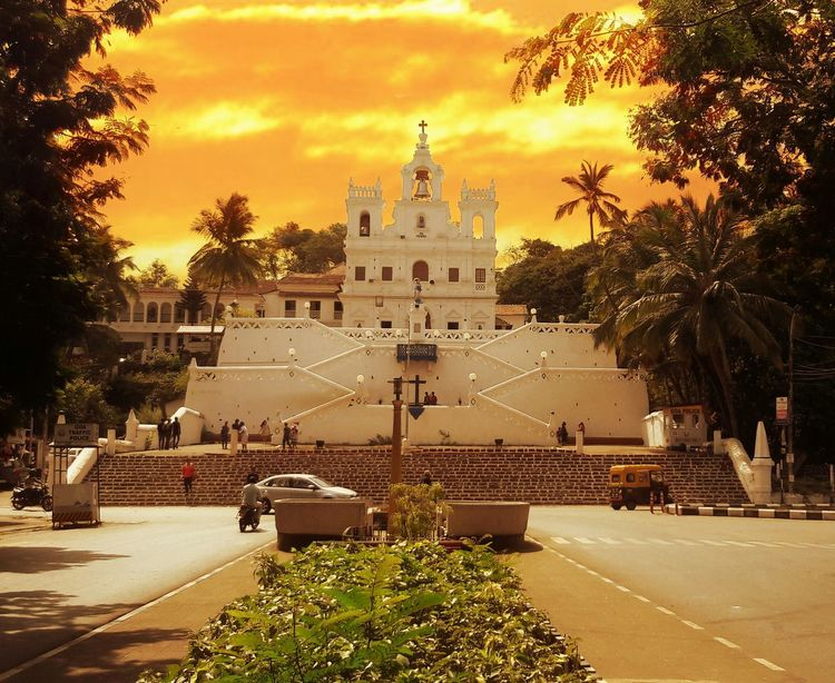 Paint The Town Yellow Tree Cloud - Sky Architecture Travel Destinations Sky Building Exterior Built Structure Outdoors Day City Church Bell Tower Goa India Immaculate Conception Temple Art Culture Rickshaw