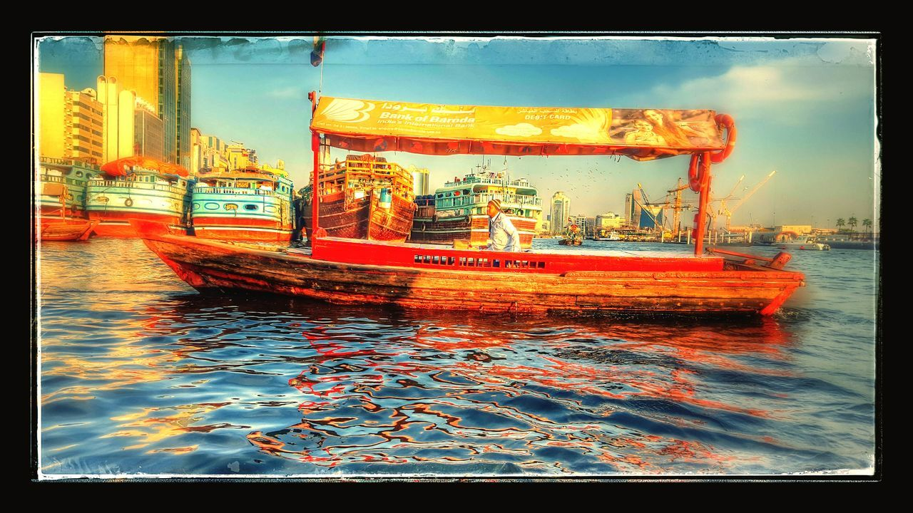 transportation, nautical vessel, mode of transport, water, outdoors, day, building exterior, sky, real people, architecture, city