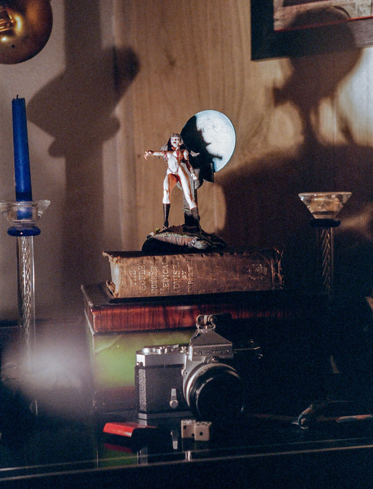 Still Life shot on 35mm film in Studio Analog Analog Camera Analogue Photography Arcane Candles Dice Figure Halloween Indoors  No People Old Books Shadowplay Shadows Shadows On The Wall Spooky Spooky Atmosphere Still Life Studio Shot Toys Turntable 35mm Film 35mm Camera
