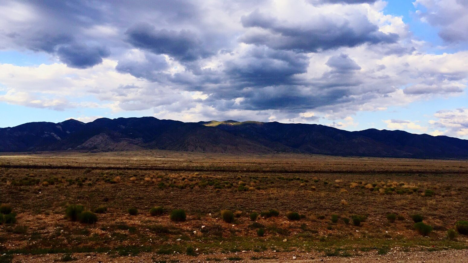 New Mexico Landscape Cloud - Sky Tranquility Sky Beauty In Nature Mountain Field Mountain Range Mountains Southwest  Newmexico Manzano Mountains Tranquil Scene Photography Landofenchantment Photographyislife Photographylovers Tranquility Nature No People Photography Themes Geology Outdoors Foothills