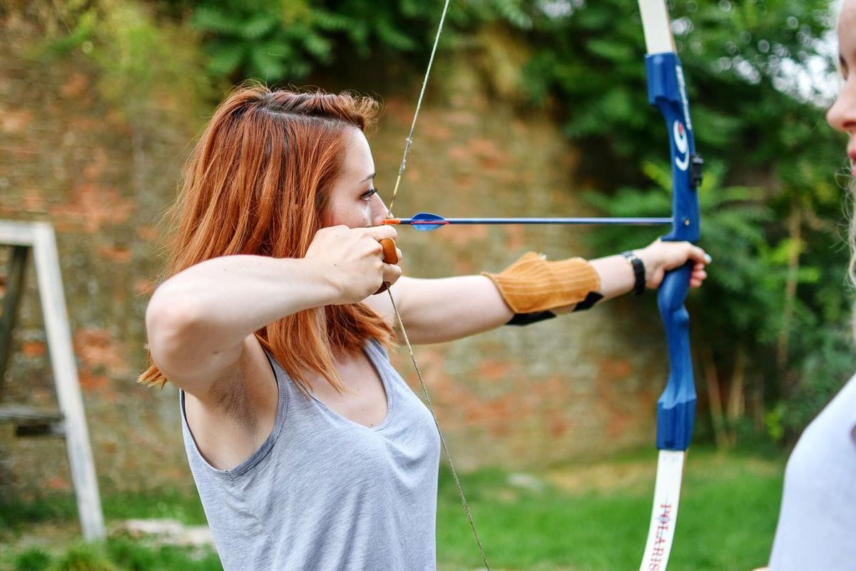 Focus On Foreground Leisure Activity Lifestyles Side View Archery Archery Girl Archery Target Archery Lesson Bowandarrow The Week On Eyem Enjoy The New Normal