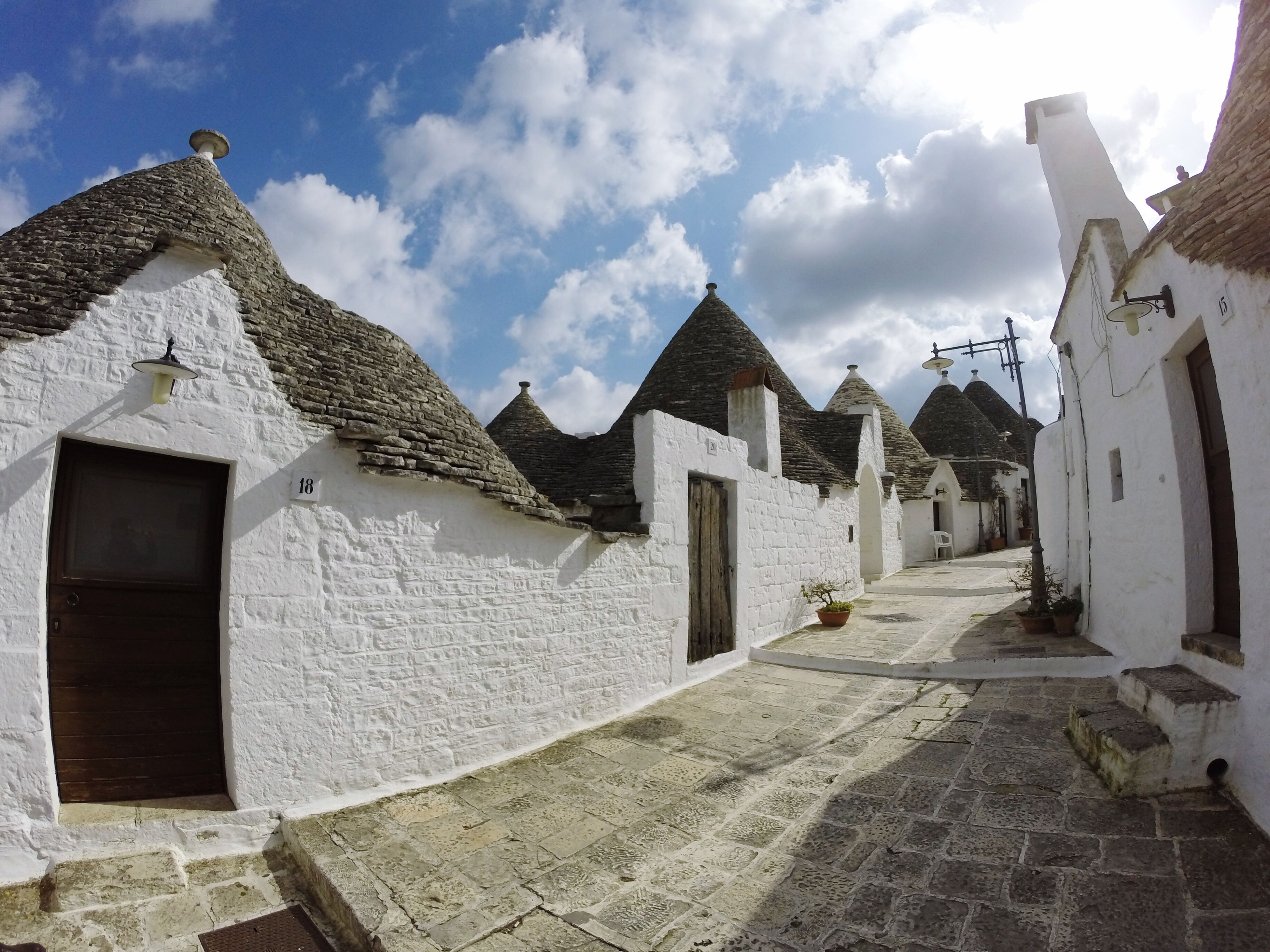 architecture, building exterior, built structure, sky, place of worship, cloud - sky, religion, spirituality, history, cloud, sunlight, church, cobblestone, day, stone wall, outdoors, facade, roof, the way forward