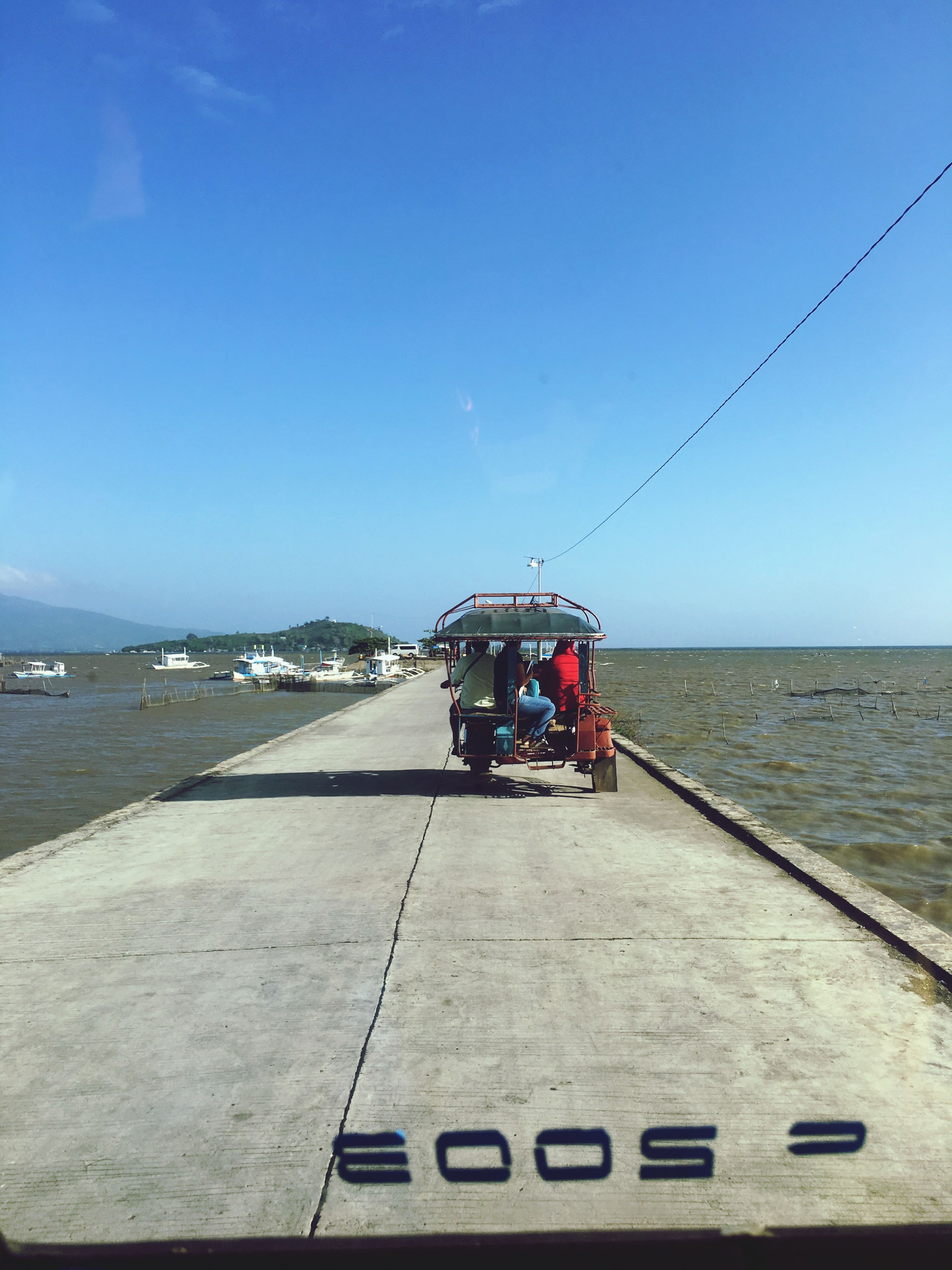 sea, sky, water, horizon over water, mode of transport, transportation, beauty in nature, clear sky, outdoors, scenics, land vehicle, nature, beach, day, no people