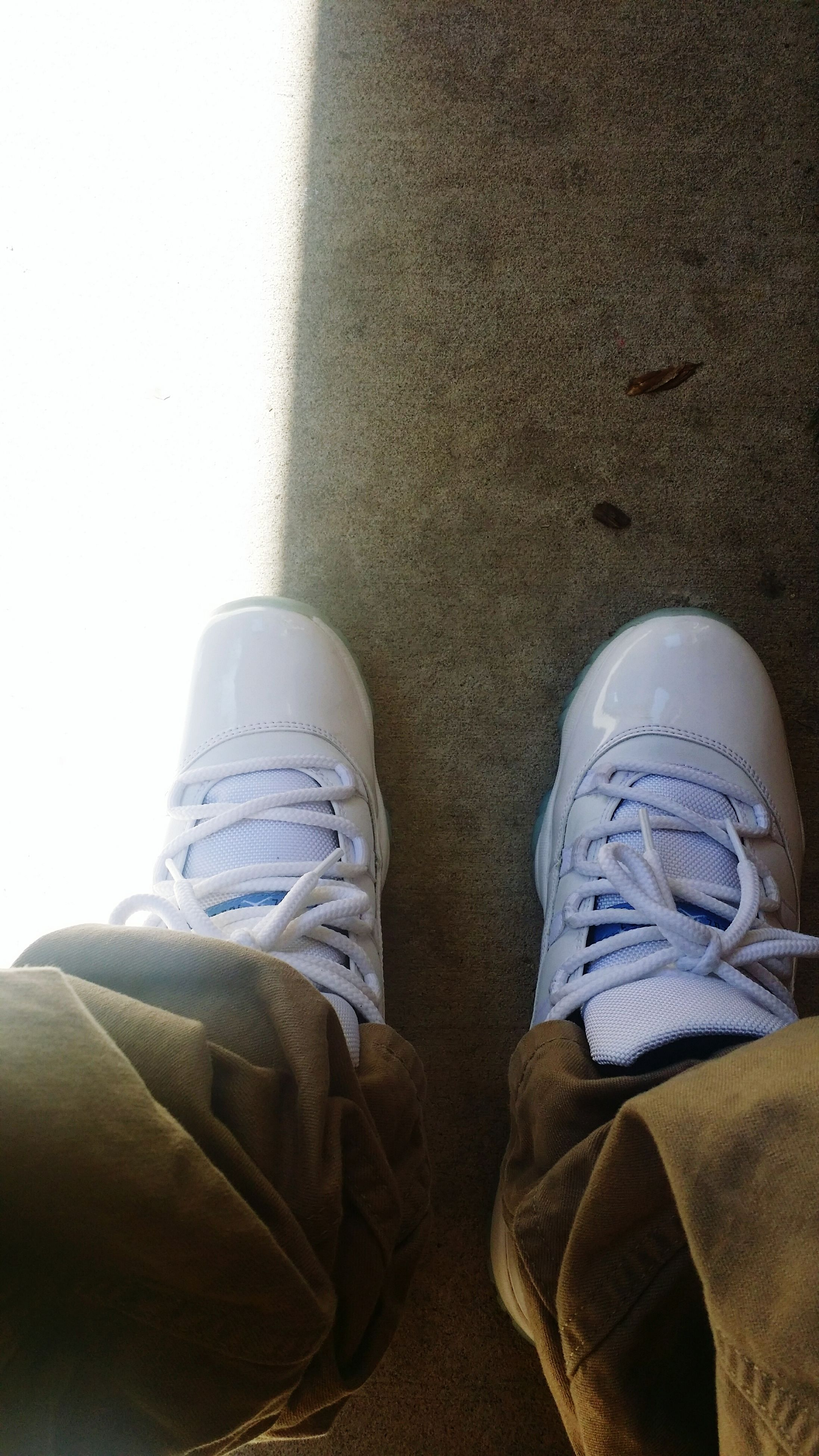 low section, shoe, person, personal perspective, jeans, lifestyles, footwear, standing, men, casual clothing, high angle view, human foot, leisure activity, close-up, day, canvas shoe, unrecognizable person