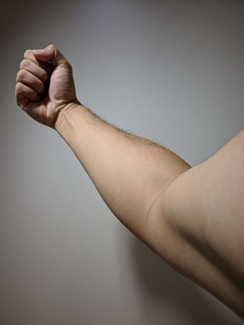 Right Hand Power Right Arm Clenched Fist Lower Arm Contracted Arm EyeEm Selects Human Body Part Human Hand Limb One Person Human Arm Close-up Adult Strength Human Finger Gesturing Men