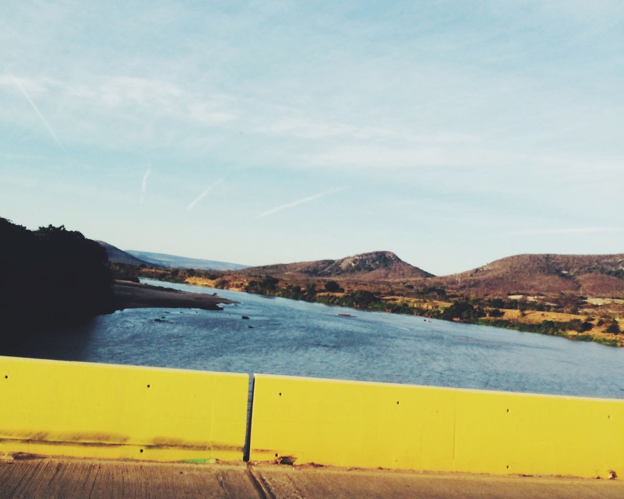 mountain, water, nature, scenics, beauty in nature, tranquility, day, outdoors, no people, river, tranquil scene, yellow, sky, mountain range