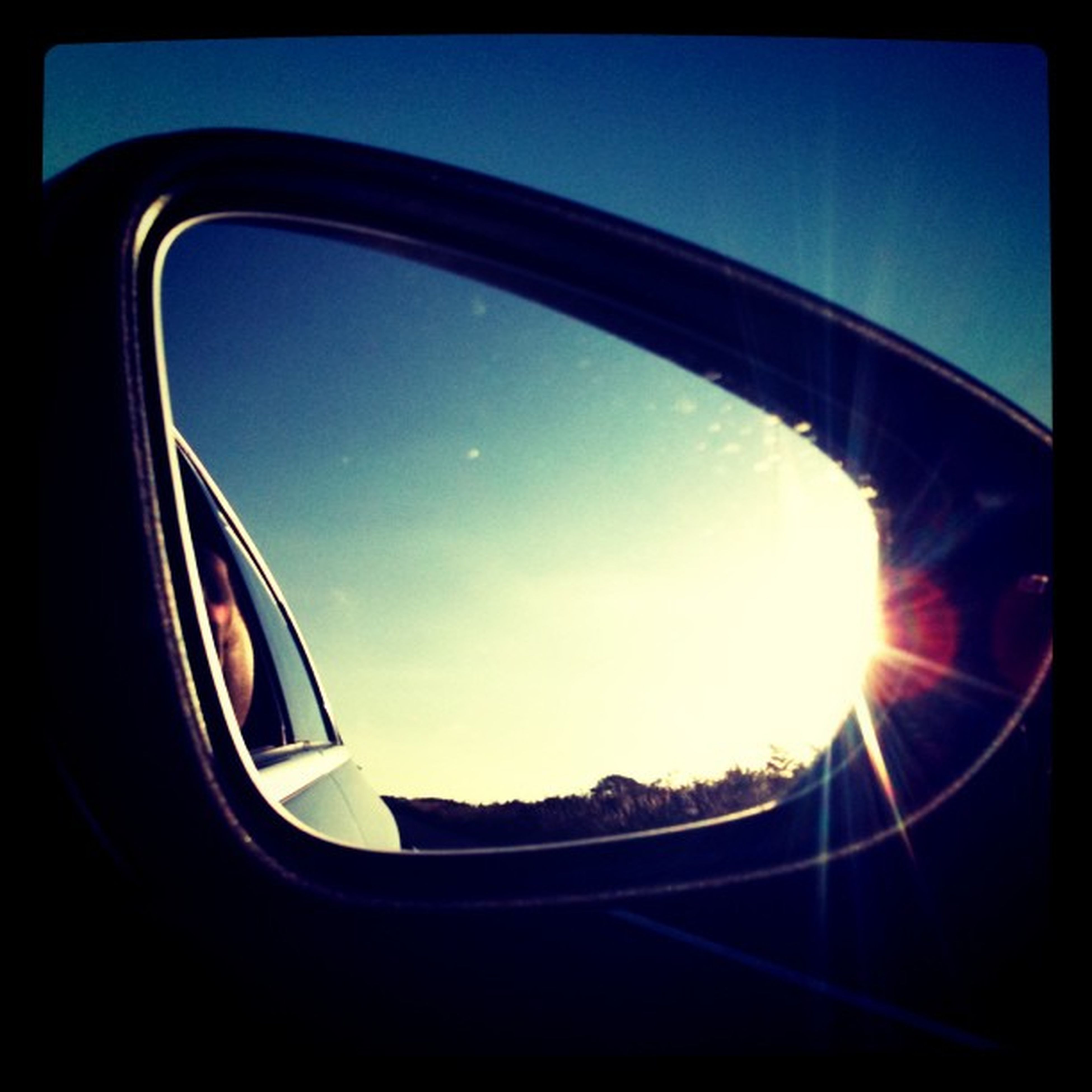 transportation, mode of transport, part of, vehicle interior, cropped, glass - material, car, airplane, sky, window, reflection, air vehicle, sun, transparent, close-up, travel, no people, blue, sunlight, side-view mirror
