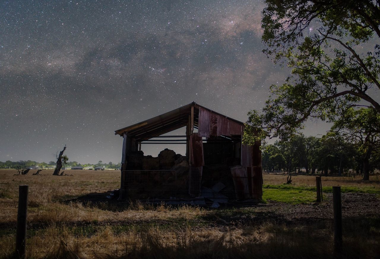 Abandoned Built Structure On Landscape Against Sky At Night