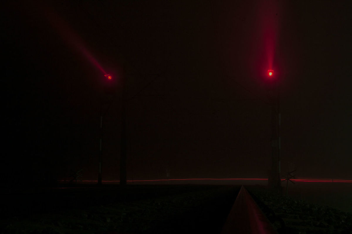Foggy Night Foggy Weather Level Crossing Nightphotography Red Darkness And Light Fog Foggy Foggy Landscape Grade Crossing Illuminated Long Exposure Longexposure Mist Misty Landscape Night Railway Railway Signal Railway Track Red Red Color Red Light Road