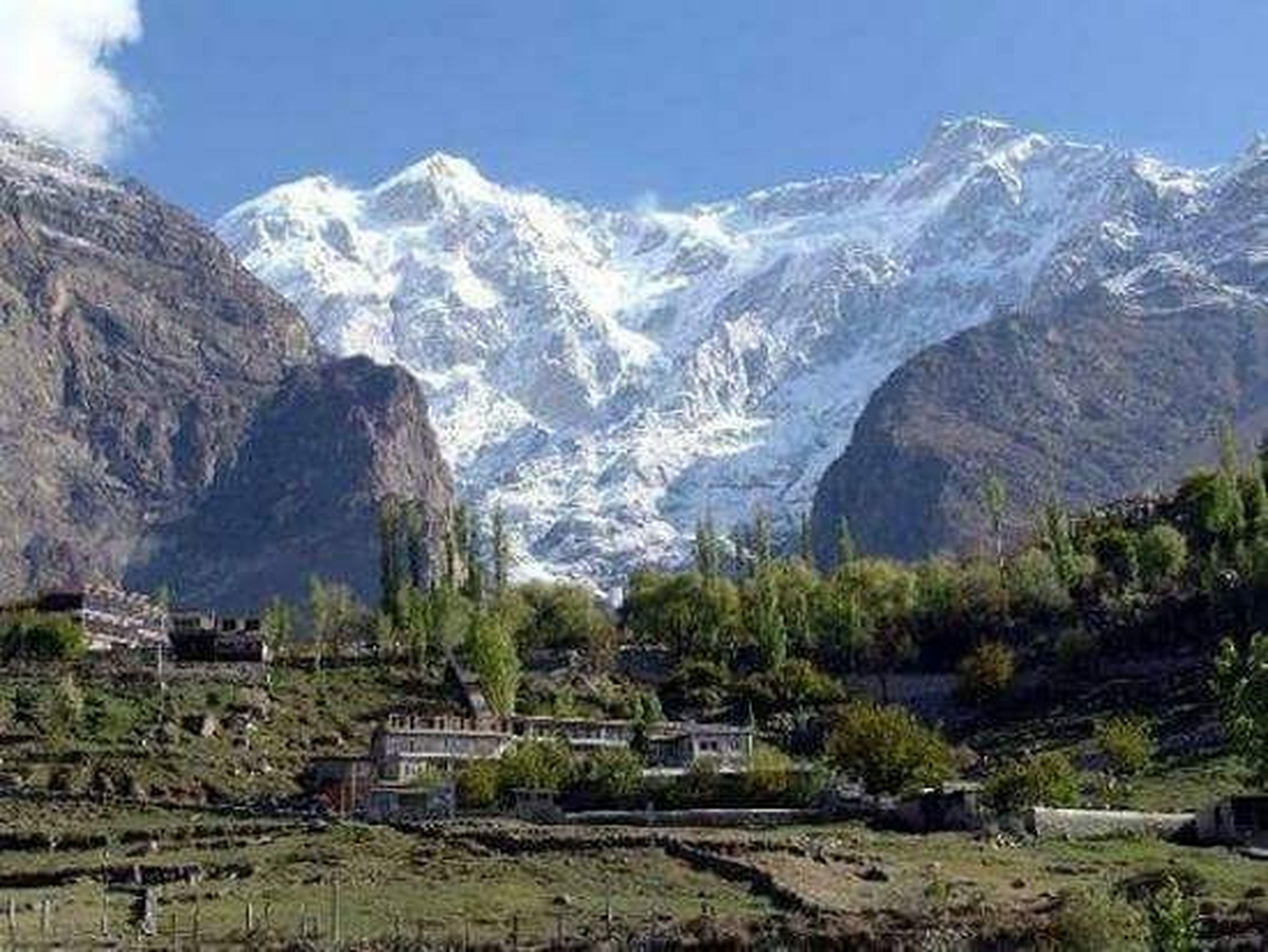 mountain, mountain range, mountain peak, landscape, snow, no people, scenics, outdoors, nature, tree, day, architecture, sky