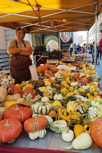 Retail  Market Variation Market Stall Abundance Large Group Of Objects Small Business For Sale Food Day Consumerism Choice Adult One Woman Only One Person Adults Only Business People Outdoors Freshness Pumpinks Healthy Food At The Market.