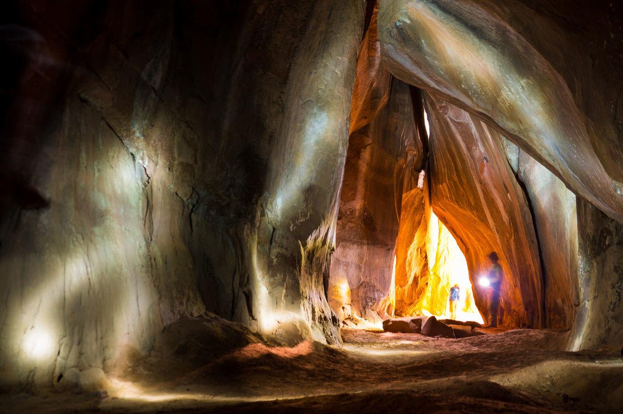 An adventurous explorer shines his torch into a dark cave lightning up the cave - Torotoro NP, BOLIVIA in September 2015 Adventure Bolivia Cave Cavern Caves Caves Photography Explore Explorer Exploring Illuminated Indoors  Light Night No People Stalactite  Torch Torchlight Torotoro Tunnel