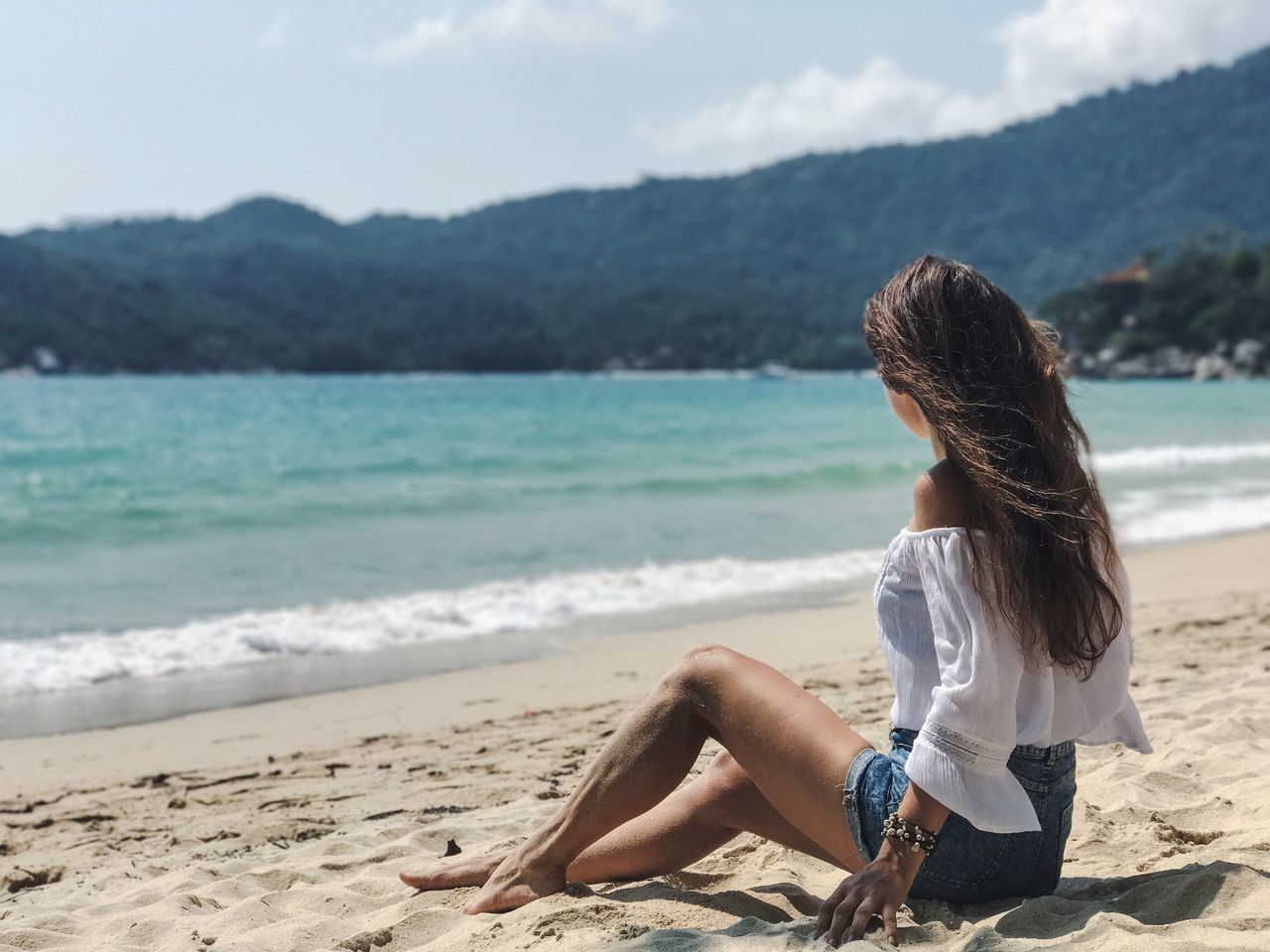 Beach Sea Sand One Person Nature Water Young Adult Day Young Women Leisure Activity Beauty In Nature Long Hair Mountain Outdoors Sky Focus On Foreground Beautiful Woman Lifestyles Scenics Real People Thailand Travel Destinations Koh Phangan Tropical Paradise Relaxing