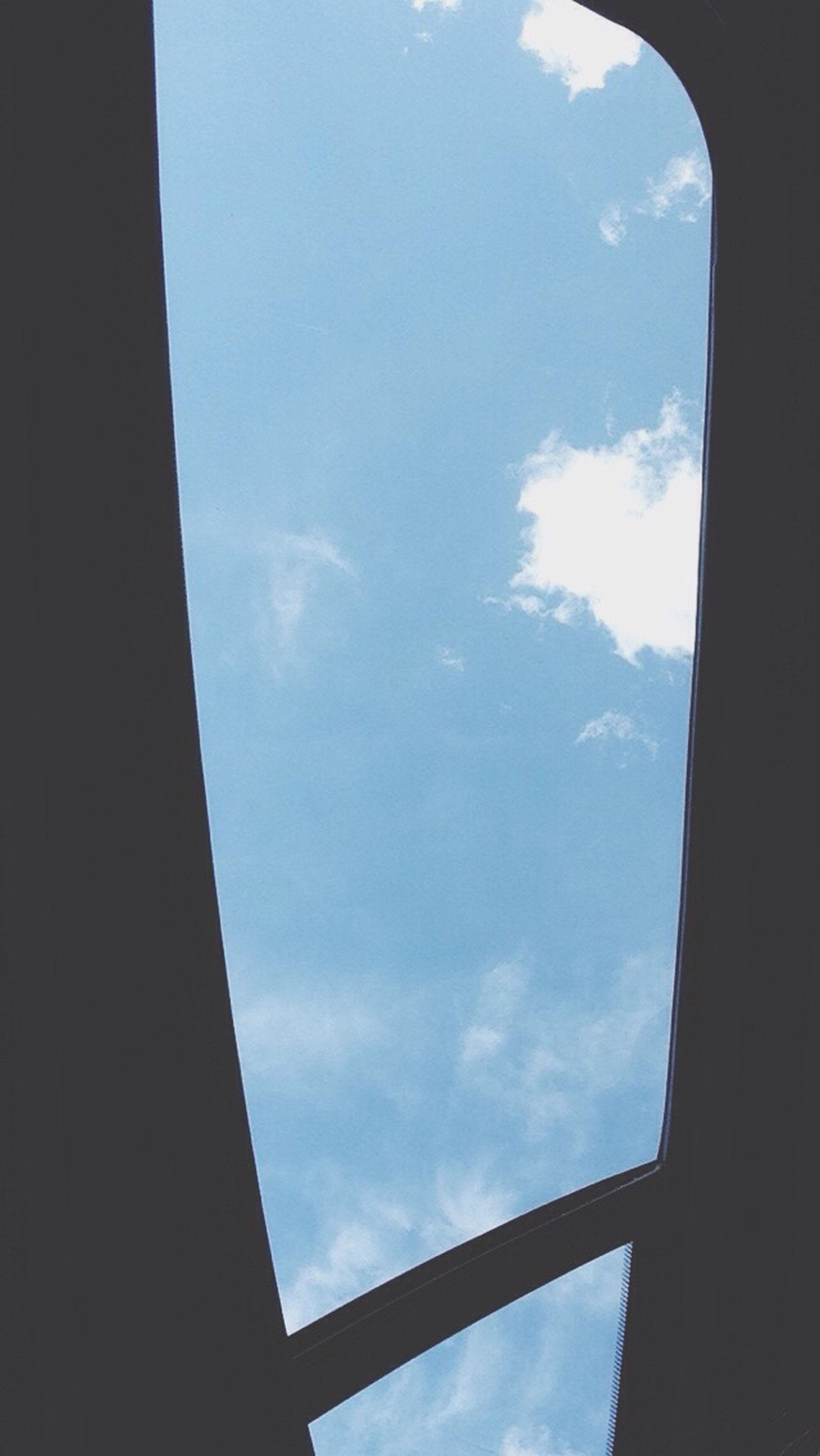 sky, low angle view, window, cloud - sky, cloud, indoors, glass - material, built structure, transparent, blue, cloudy, day, architecture, no people, sunlight, nature, part of, directly below, silhouette