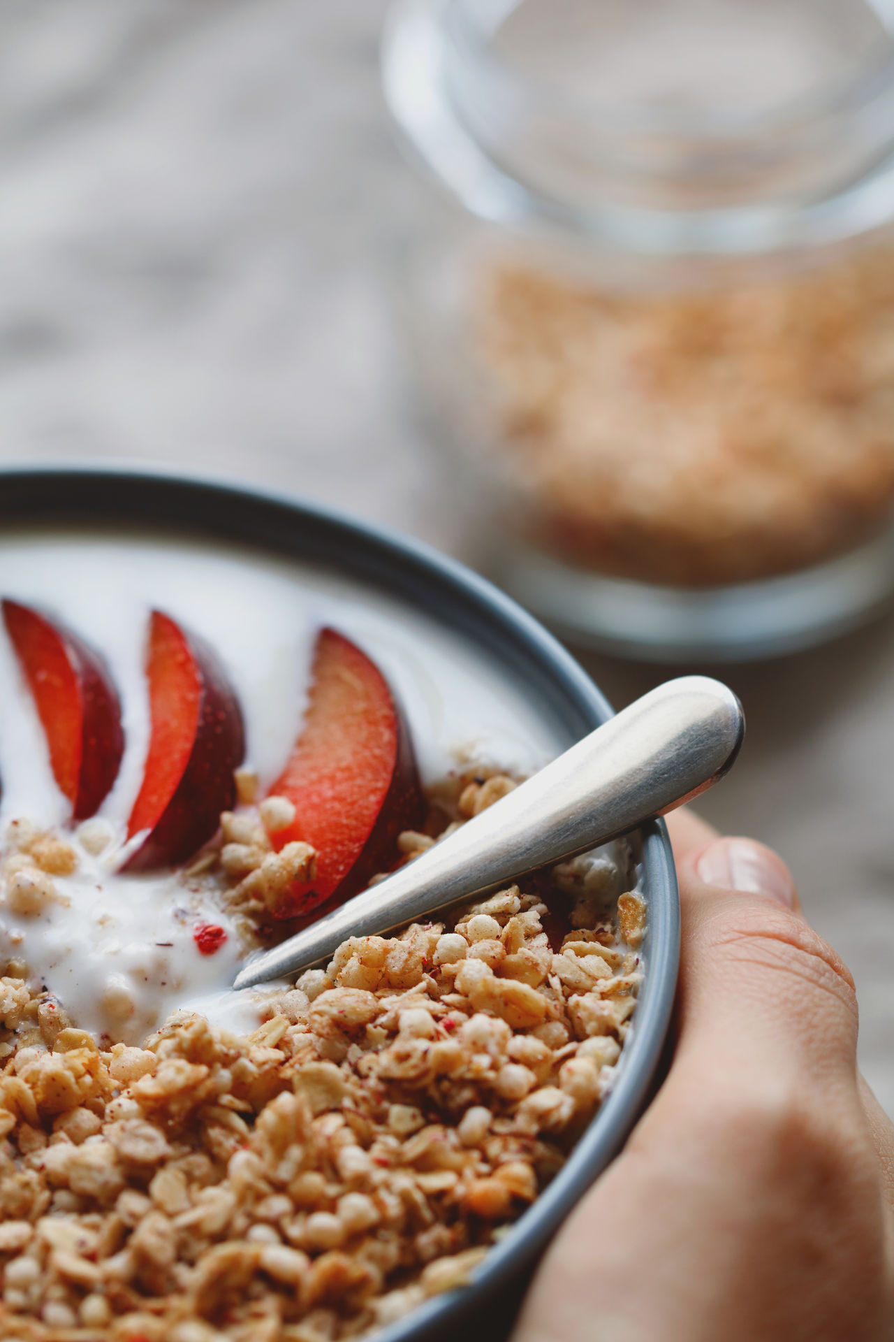 Adult Bowl Breakfast Breakfast Cereal Close-up Food Food And Drink Freshness Healthy Eating Healthy Food Healthy Lifestyle Human Body Part Human Hand Milk Morning One Person People Plum Ready-to-eat Selective Focus Table