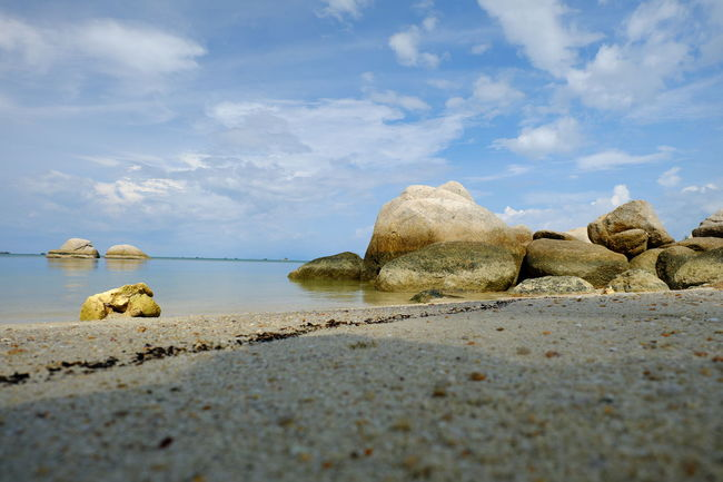 Beach Beauty In Nature Calm Cloud - Sky Nature Pebble Rock - Object Sand Scenics Sea Shore Sky Stone - Object Surface Level Tourism Tranquil Scene Tranquility Water
