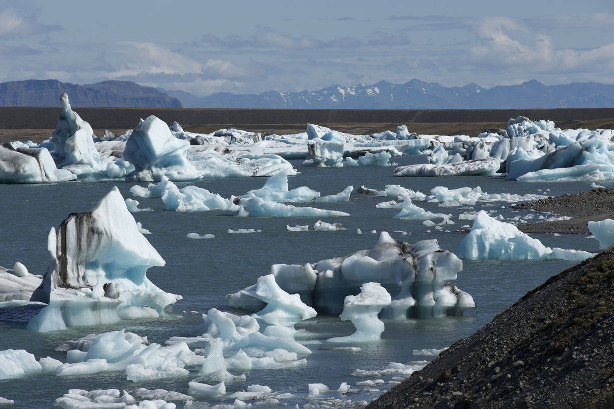 Iceberg Lagoon Jokulsarlon Iceland Filled With Glacial Icebergs Beauty In Nature Cold Temperature Day Floating On Water Frozen Glacier Ice Iceberg Iceberg - Ice Formation Iceberg; Ice; Lagoon; Glacier; Jokulsarlon; Nature; Iceland; Water; Arctic; Sea; Melting; Scenics; Climate; North; Atlantic Ocean Lake Melting Mountain Nature No People Outdoors Remote Scenics Sky Snow Tranquil Scene Tranquility Water White Winter