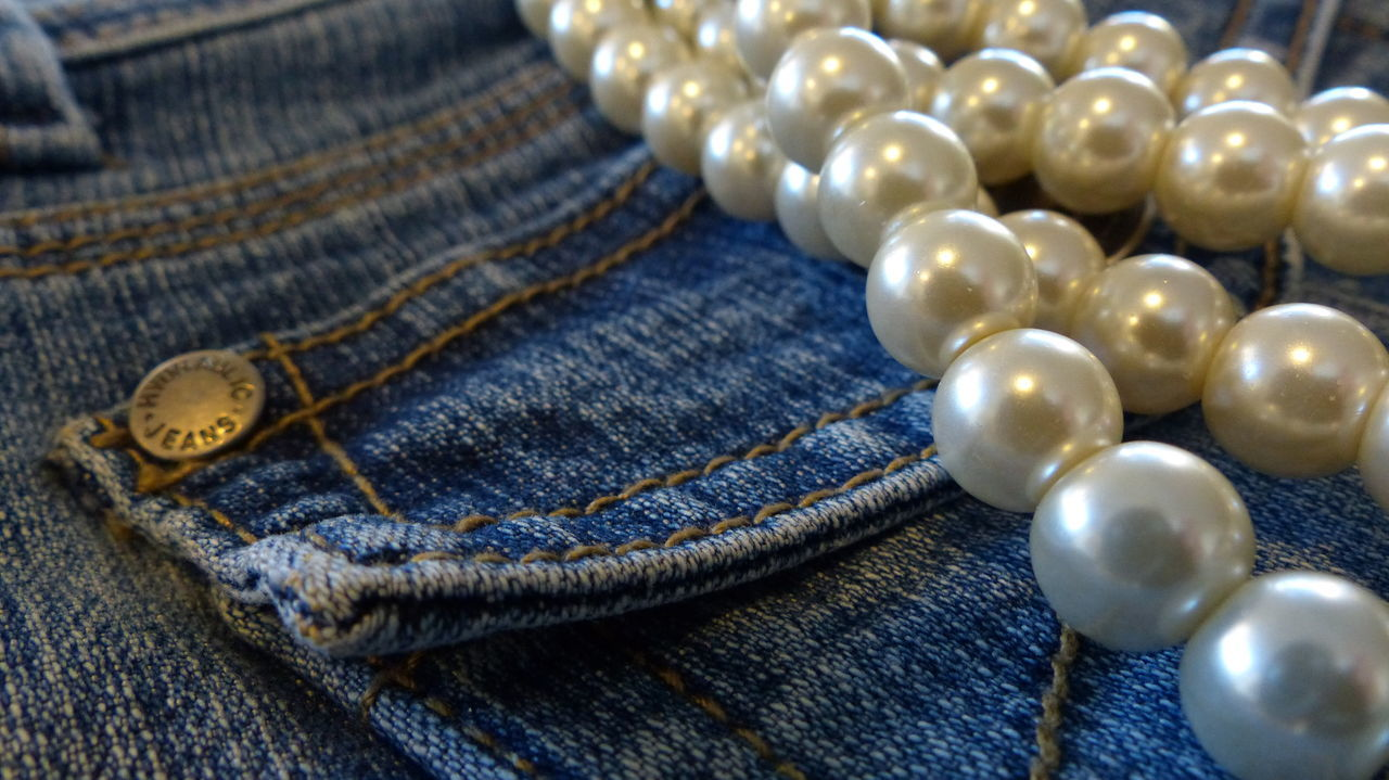 Blue Jeans and white pearls Blue Jean Blue Jeans And Pearls Blue Jeans Close-up Casual Clothing Close-up Denim Denimjeans Jewelry Jeans No People Pearl Necklace  Pockets
