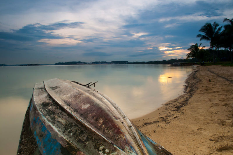 Life Is A Beach Long Exposure Seascape Sky And Clouds Parked Boat Sampan At Pasir Ris Seaside Nobody In Landscape Scenic Singapore Serene Tranquil Outdoors Fine Sandy Coast Shore