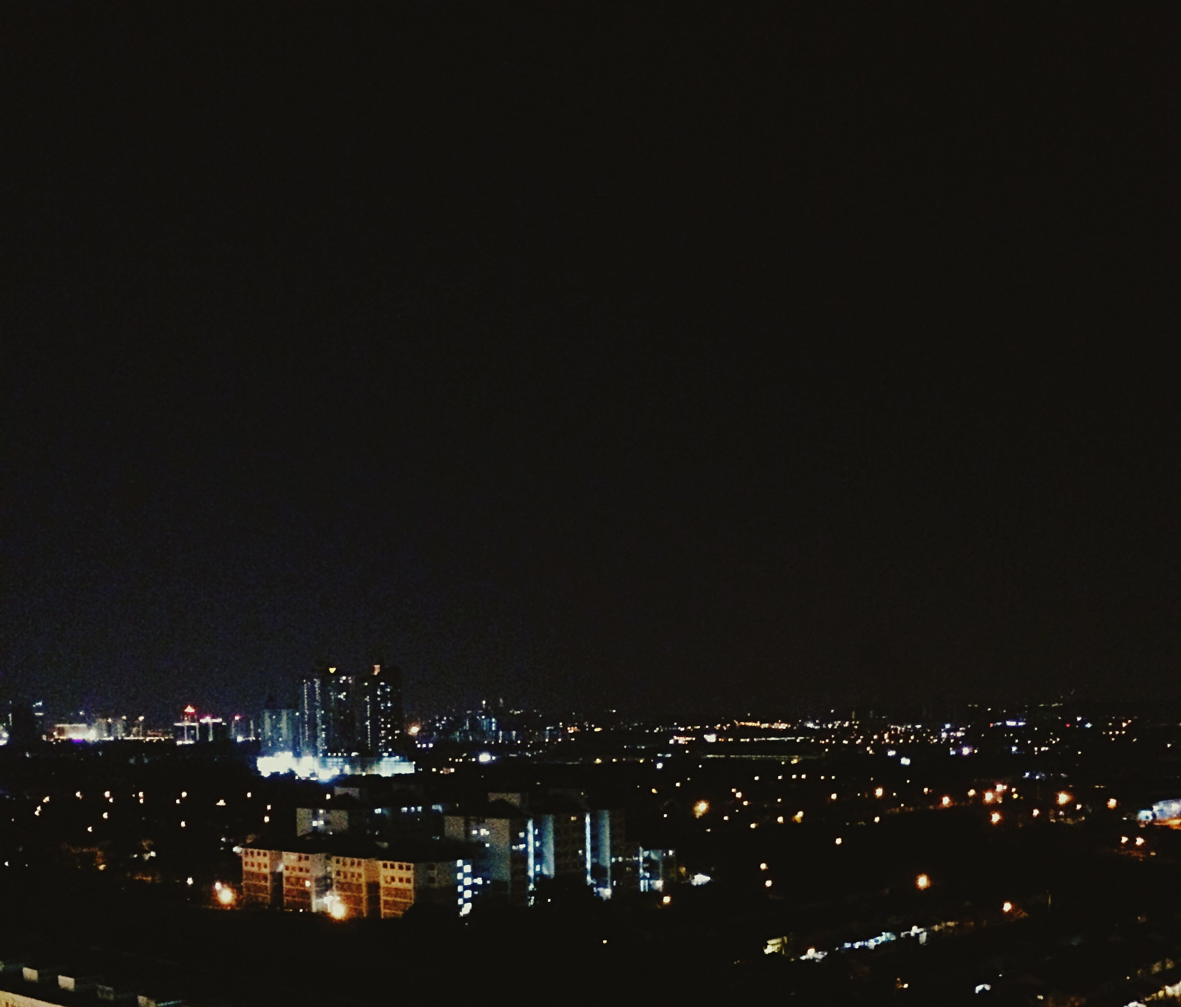 night, illuminated, city, cityscape, building exterior, architecture, built structure, copy space, dark, clear sky, sky, city life, river, high angle view, outdoors, light, no people, light - natural phenomenon, residential building, crowded