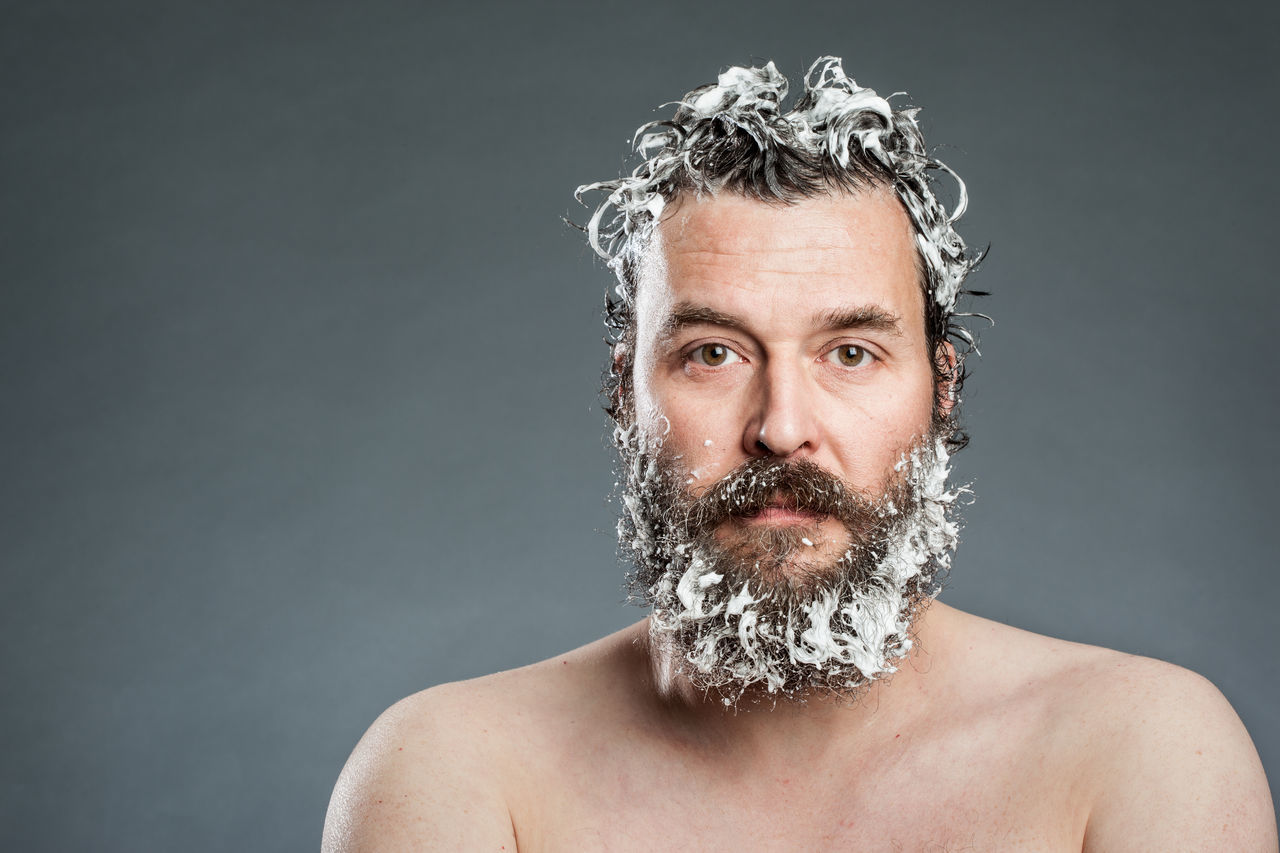 Hipster Troubles, Studio shots of a Bearded man washing his Hair and Beard, on Grey Background 40 Years Old Adults Only Beard Bearded Close-up Conceptual Funny Gray Background Grooming Grooming Beard Headshot Hipster Lifestyles Mid Adult One Man Only One Person Only Men Portrait Shampoo Shower Studio Shot Washing