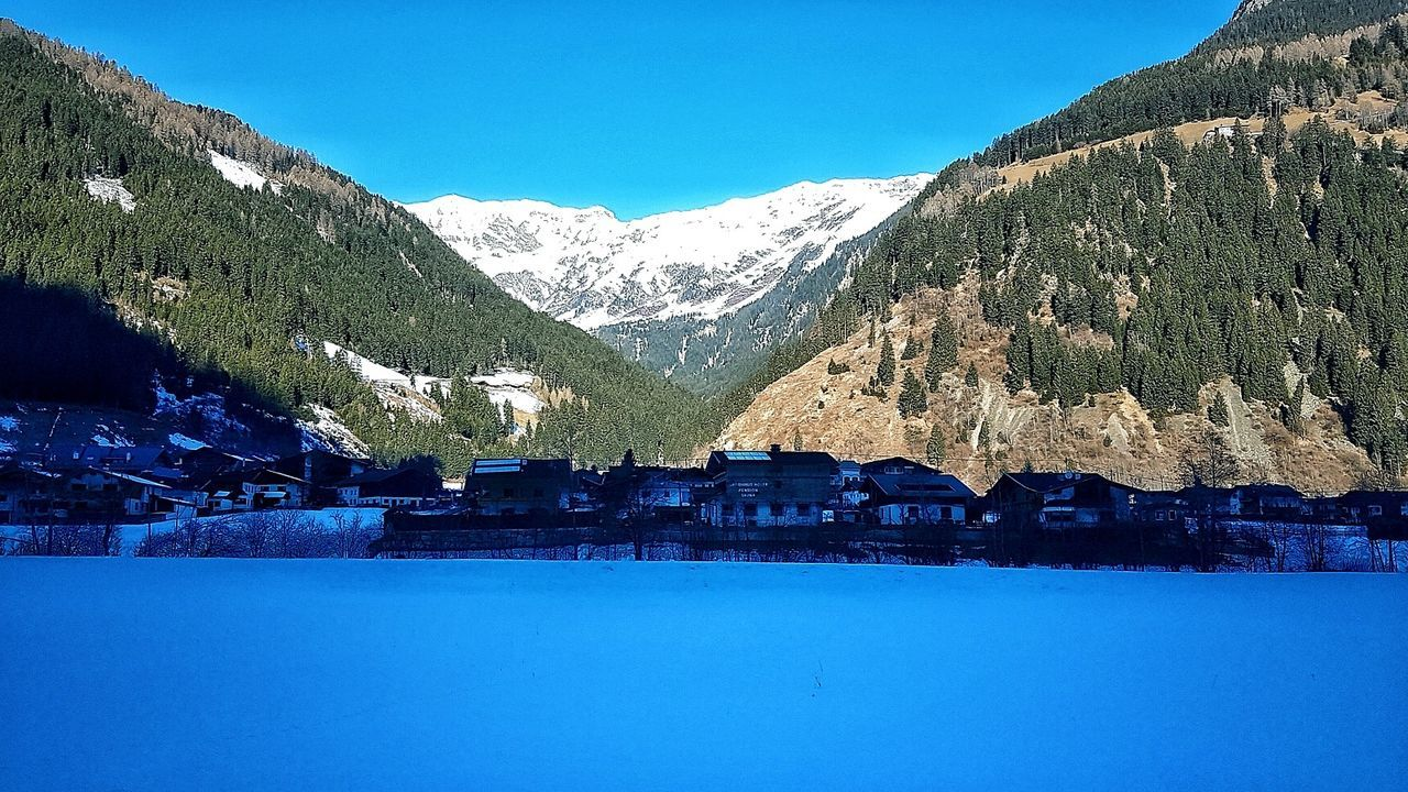Blue Sky Nature No People Landscape Cold Temperature Beauty In Nature Tree Mountain Outdoors Day Reflection Snow ❄ Nature Photography Beauty In Nature Natural Phenomenon Mountain Range Winter Sunshine Natur Pur :)  Cloud - Sky Sunlight
