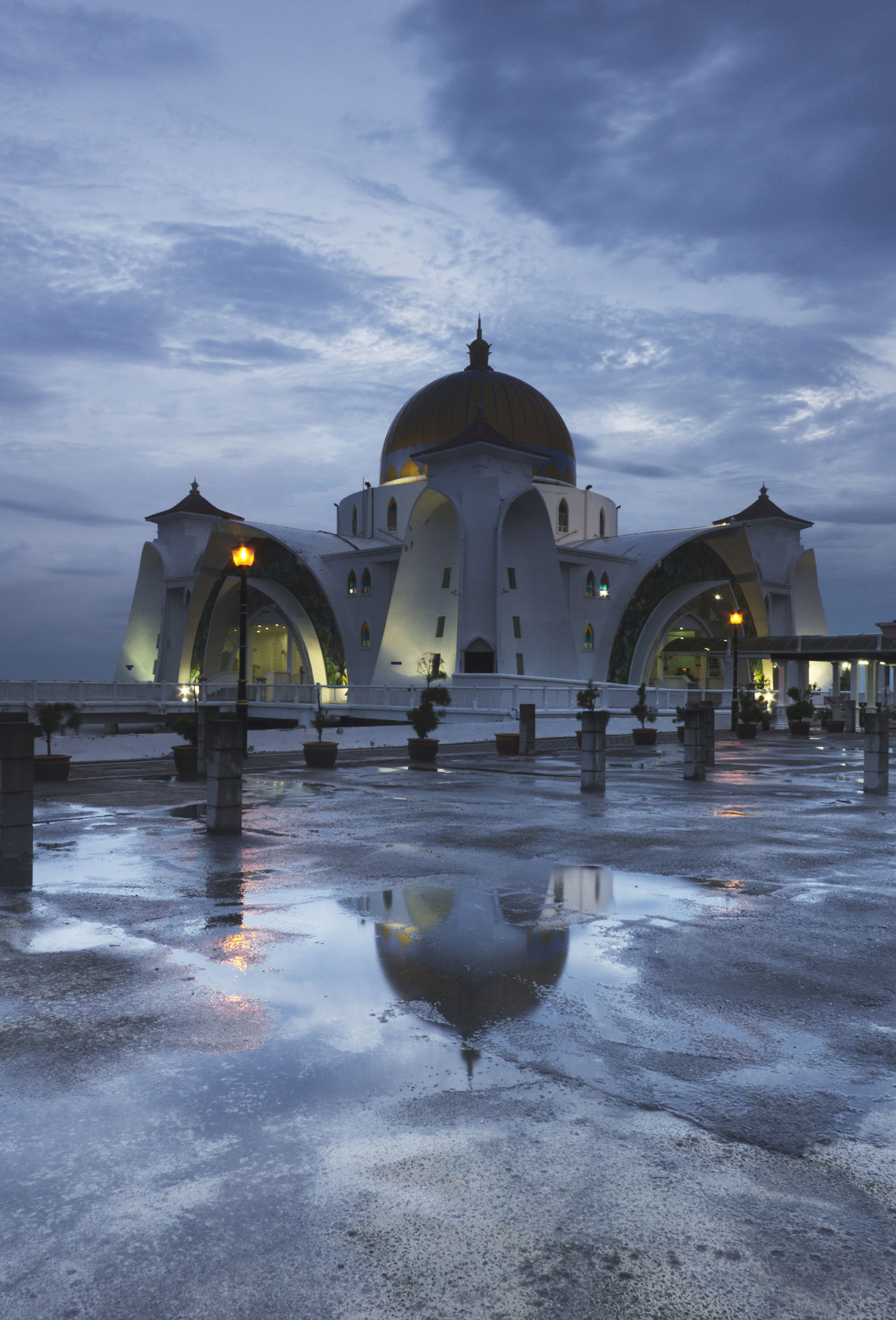 Reflection of dome after rain on tarmac. Architecture Building Exterior Built Structure Cloud - Sky Cold Temperature Day Dome Islam, Muslim, Mosque, Islamic, Religion, Ramadhan, Eid, Ramadan, Arabic, Faith, Religious, Prayer, Architecture, Arab, Background, Pray, Mubarak, Worship, Culture, Building, Traditional, Design, Arabian, Holy, Masjid, Spiritual, East, Sky, Landmark, Asia Nature No People Outdoors Place Of Worship Religion Sky Snow Spirituality Travel Destinations Water Winter