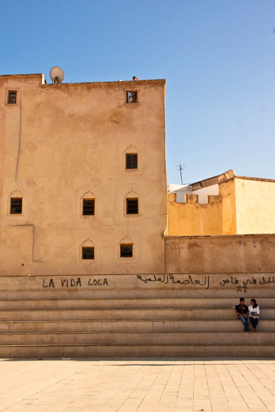 Wall Arabian Culture Morocco La Vida Loca Street Streetphotography People Street Life Couple On Wall Couple On Stairs Stairs Blue And Yellow