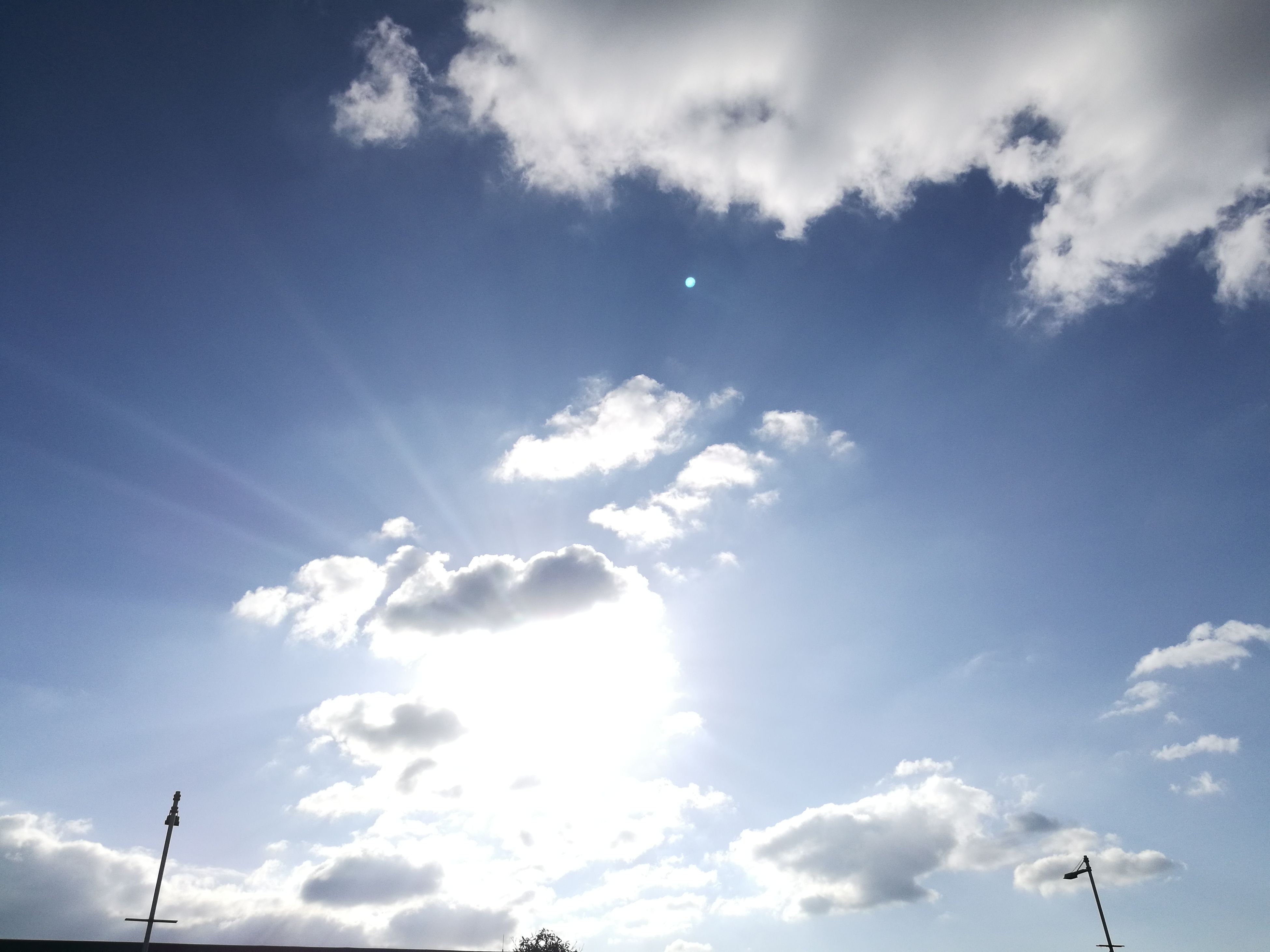 sky, low angle view, cloud - sky, nature, no people, sunlight, tranquility, beauty in nature, outdoors, day, sun