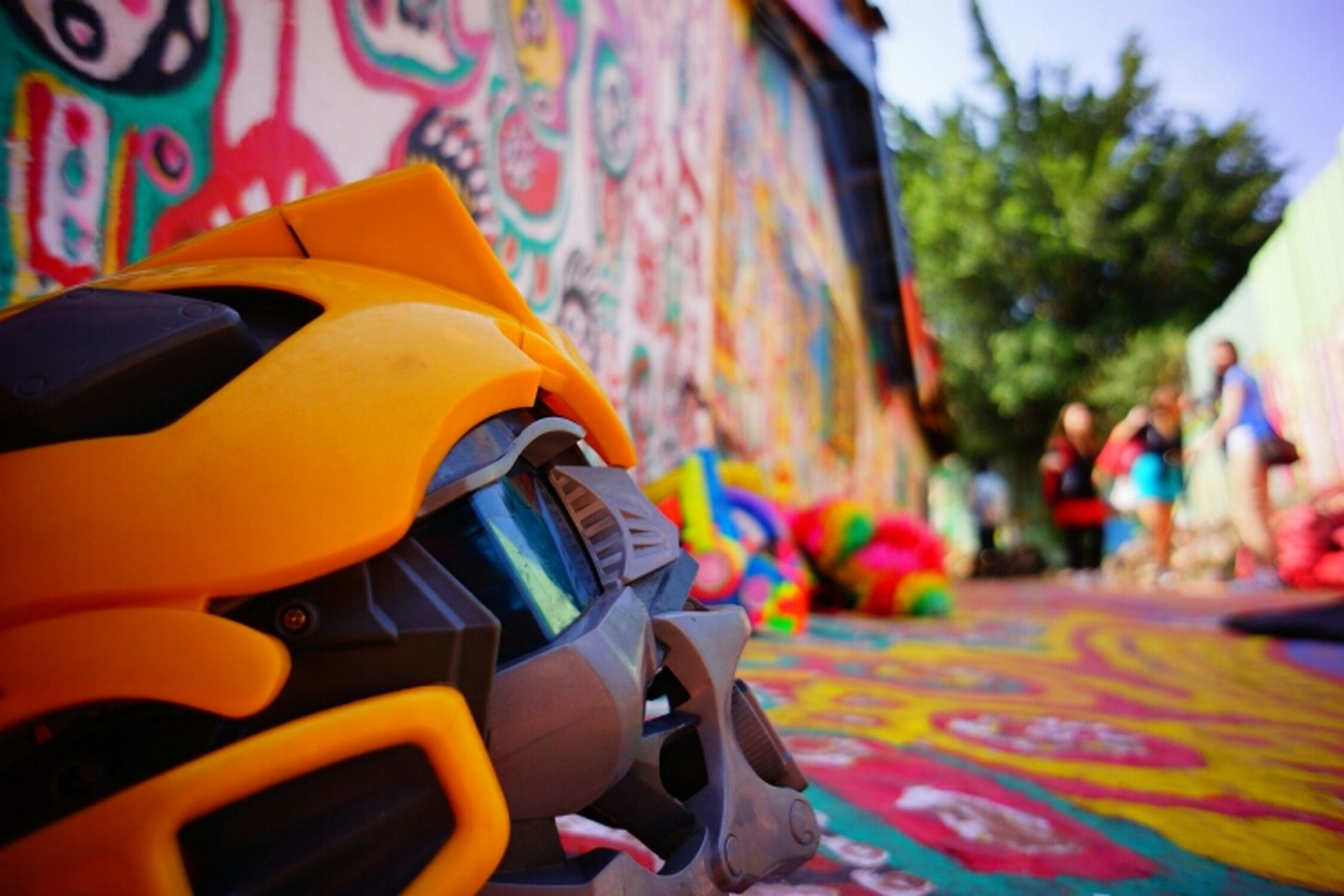 multi colored, focus on foreground, incidental people, art and craft, arts culture and entertainment, close-up, cultures, colorful, tradition, outdoors, creativity, day, art, street, celebration, tree, toy, leisure activity, car