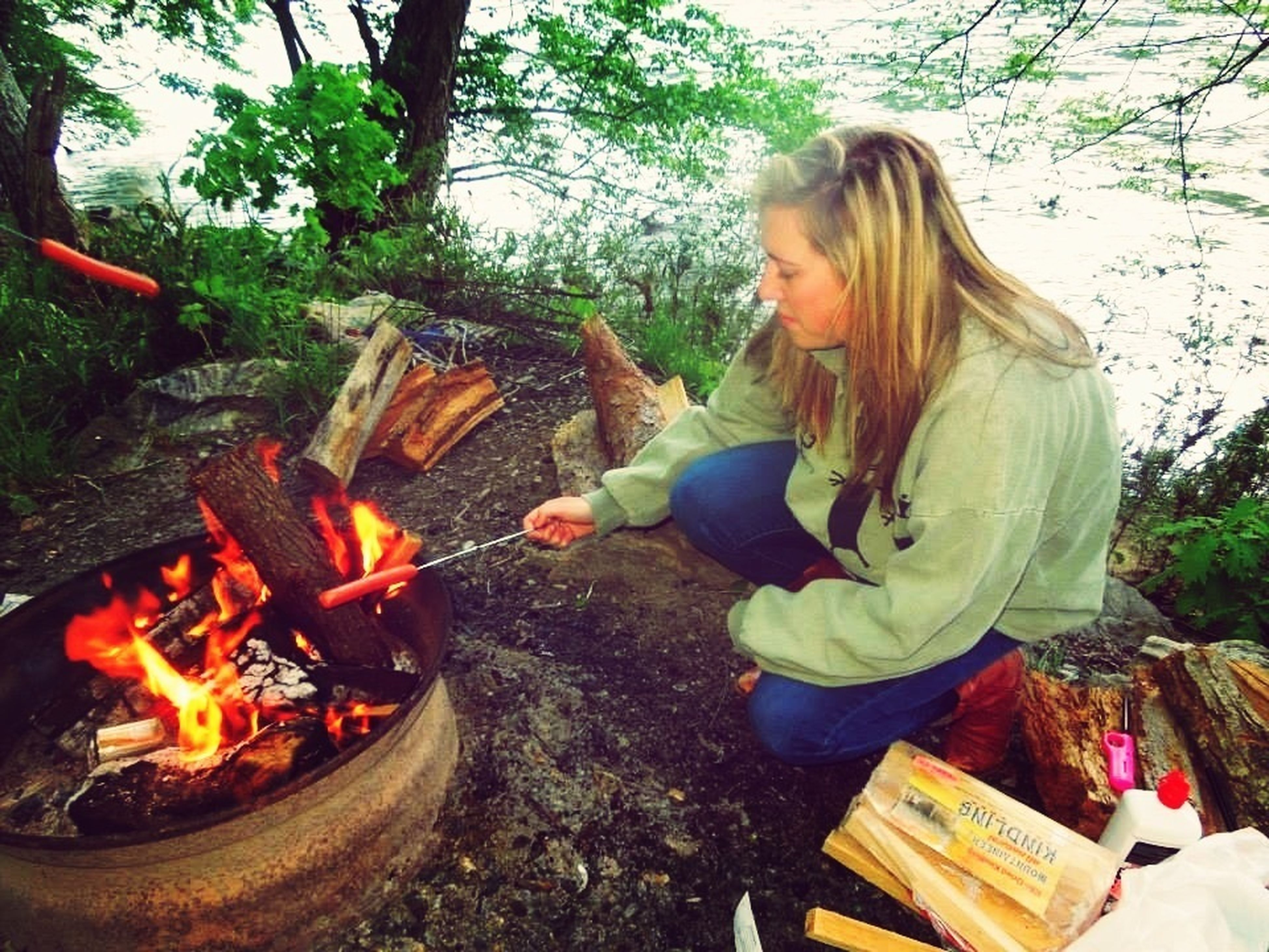 lifestyles, leisure activity, burning, flame, tree, fire - natural phenomenon, sitting, casual clothing, enjoyment, outdoors, vacations, togetherness, full length, men, day, person, heat - temperature, girls