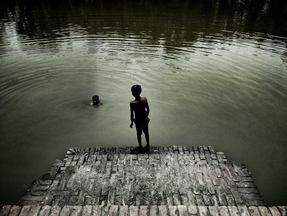 The Swimmer. (Khulna, Bangladesh) One Person Water Full Length Real People Standing One Man Only Outdoors People Nature Day Men Built Structure StillLife EyeEm LOST IN London EyeEmNewHere EyeEm Selects The Street Photographer - 2017 EyeEm Awards Breathing Space Steps Staircase Stairs Skill  Minimal Composition Street Photography Street